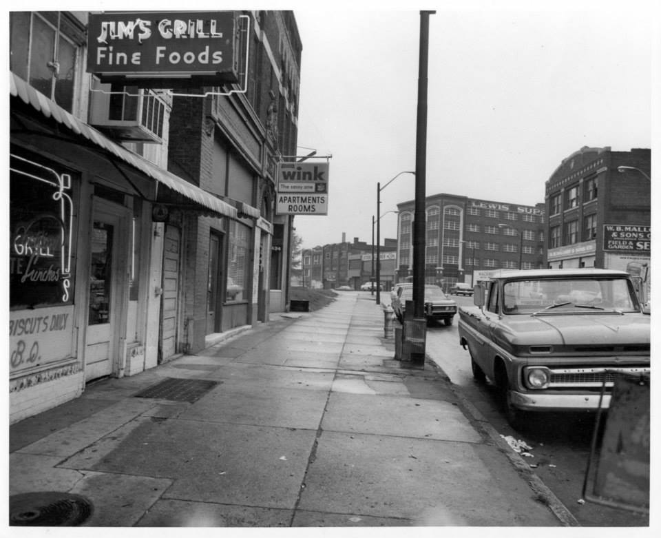 Photo 8- Entrance to Jim's Grill and Boarding House sign on background.jpg