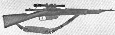 The Carcano Located on the Sixth Floor of the Texas SchoolBook Depository SHortly After Shots Are Fired Was Discovered BY Dallas Police and Recorded by Journalists