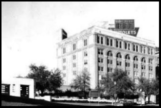An Eastern view of The Texas Schoolbook Depository Across Elm Street in Downtown dallas Circa 1963