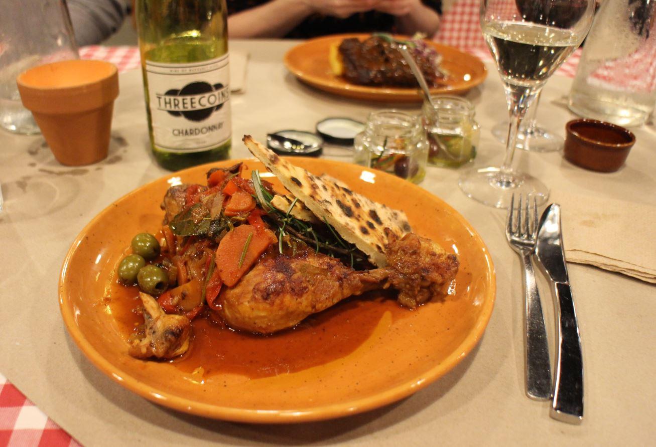 Chicken cacciatora ~ free range chicken drumstick braised in white wine sauce, olives, capsicum served w/ traditional Umbrian focaccia
