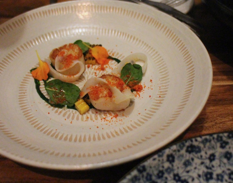 Scallops, corn, spinach and shaved squid