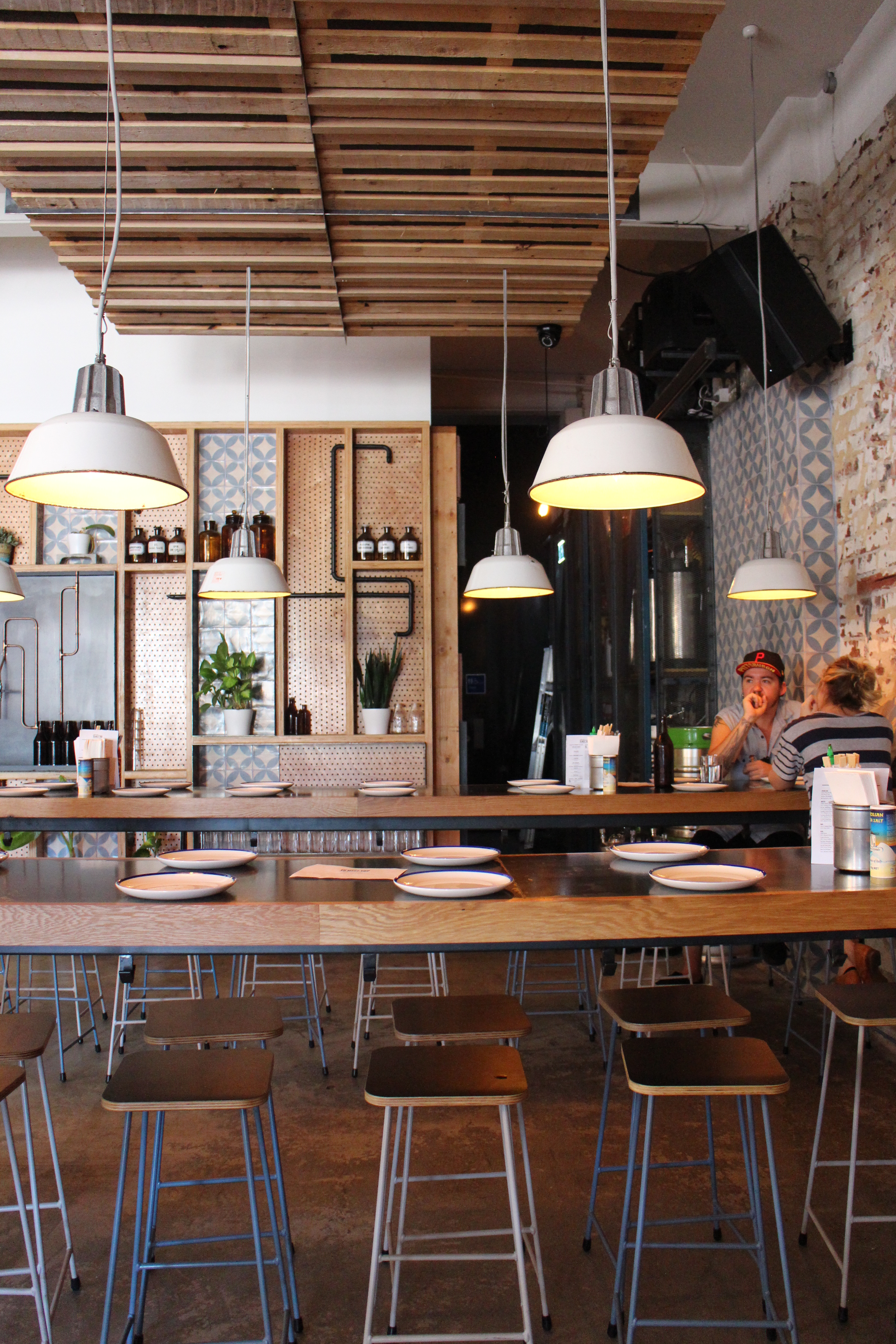 I love the fit out with its punches of cool blue, exposed brick, low hanging warehouse lights and pretty tiles.