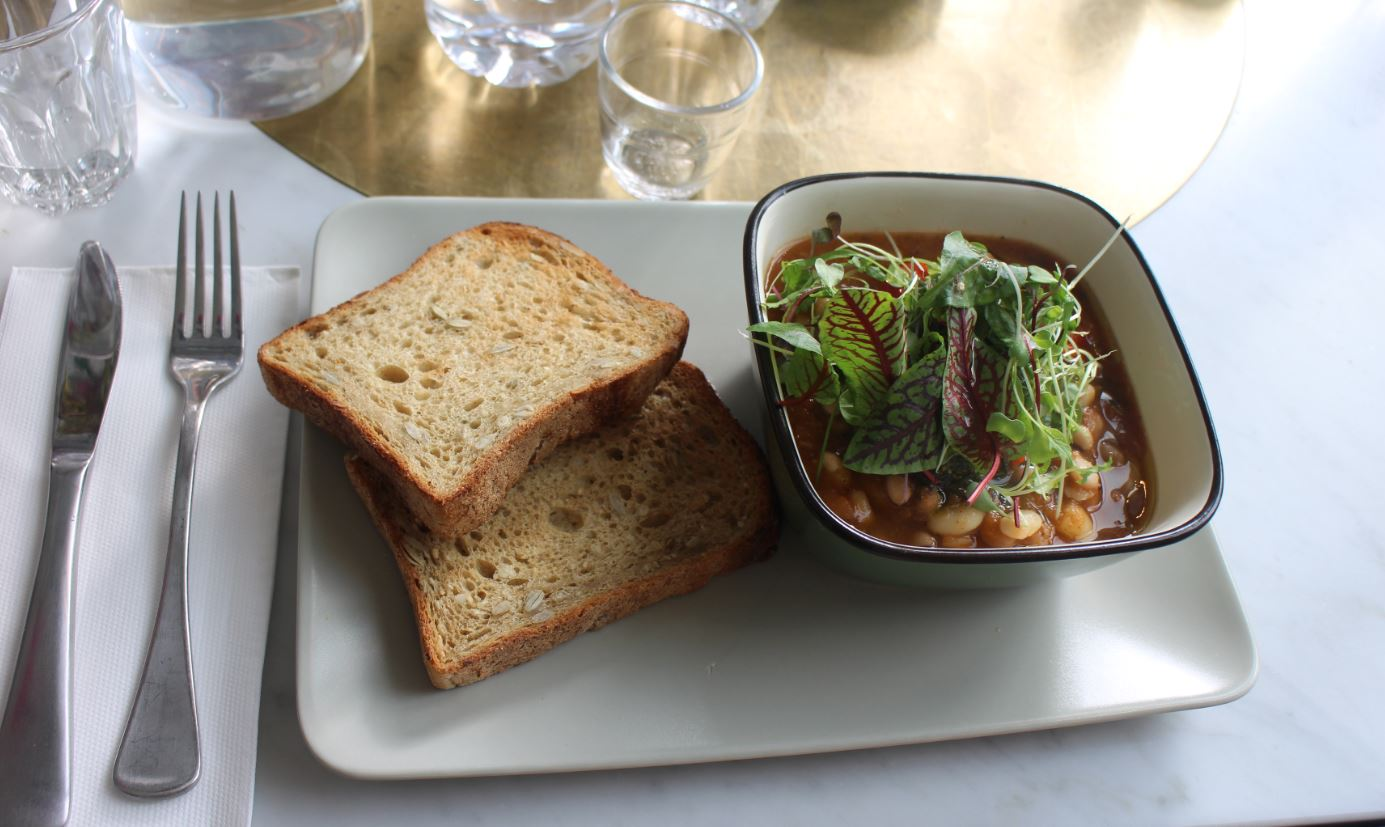 Mixed beans with house-made tomato sauce, basil and toast $15