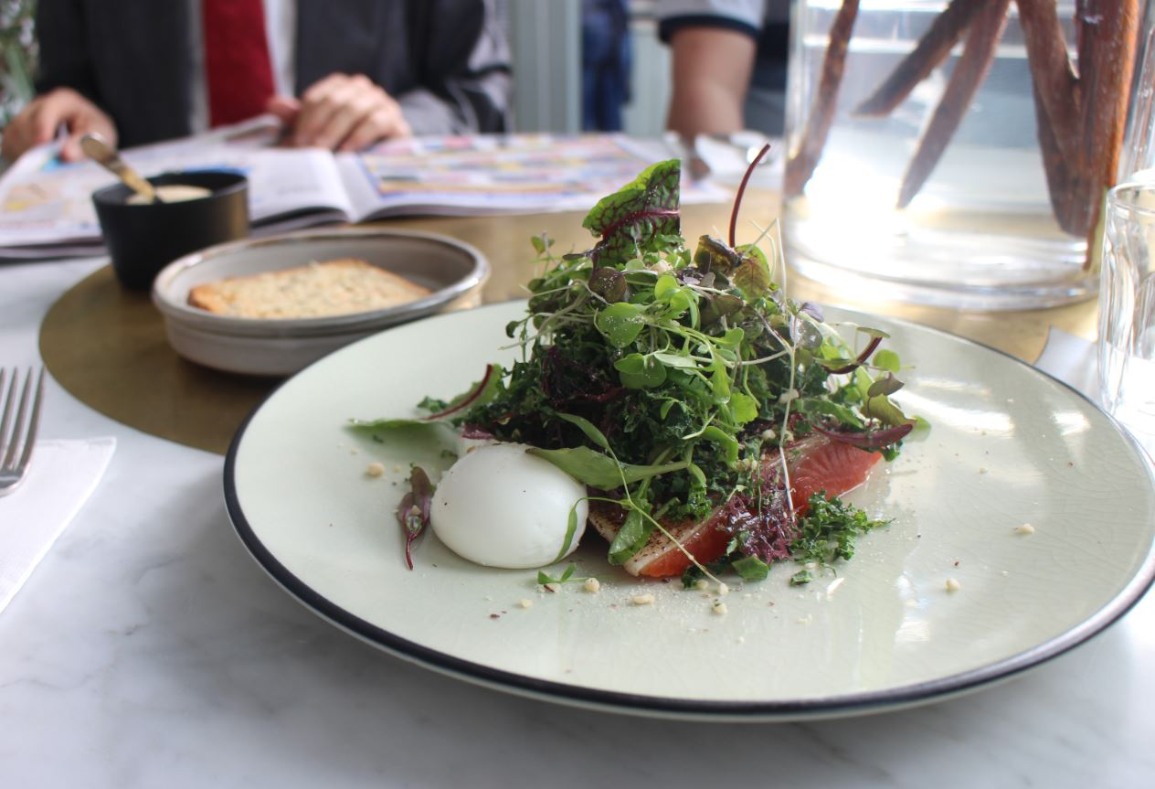 Tataki ocean trout with a raw kale and pickled seaweed salad, nuts and poached eggs $20