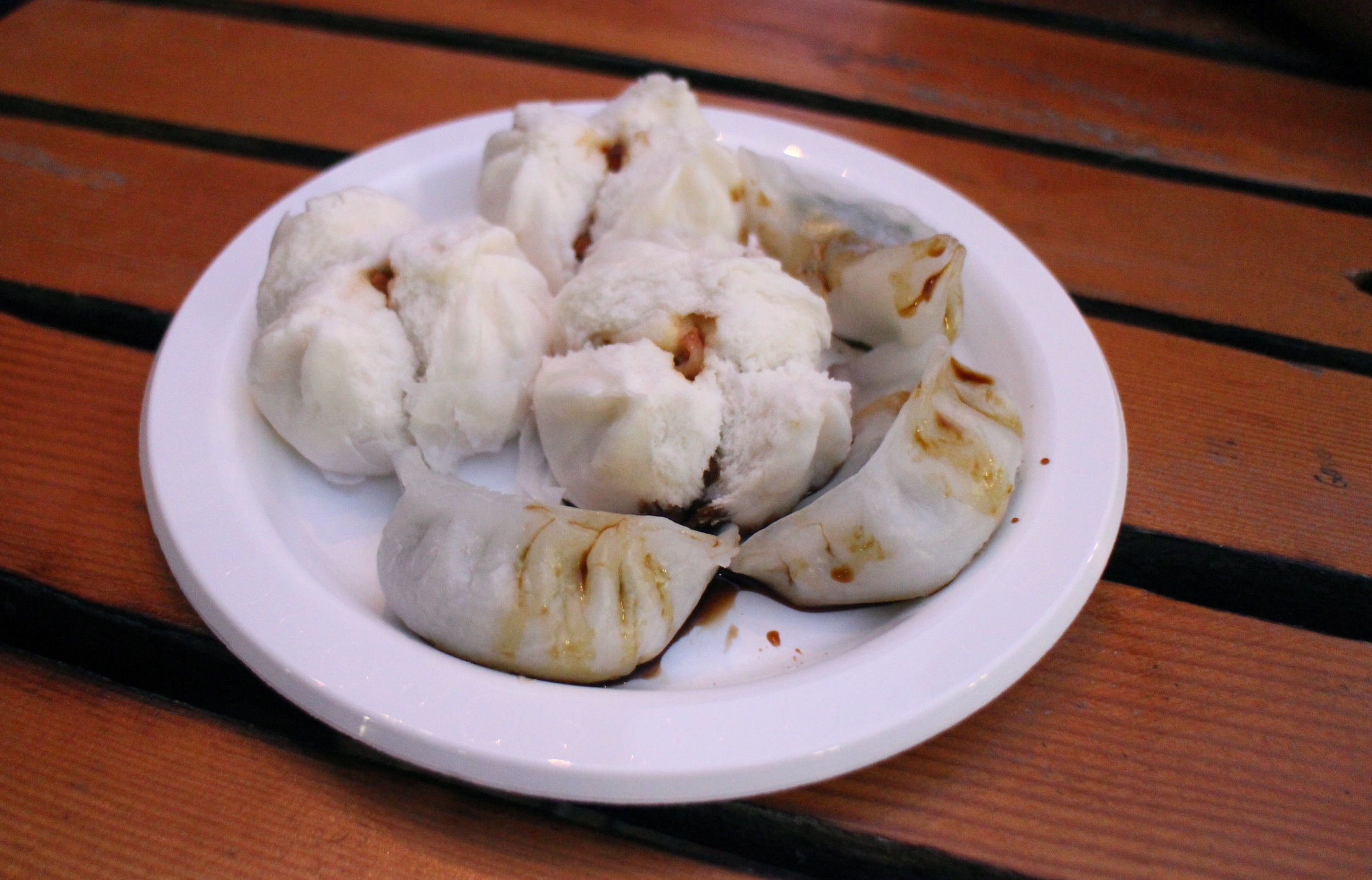 Who: Let's Do Yum Cha   Where: Central Square   What: Steamed BBQ pork bao, Prawn andchive dumplings Tip: The signs are a little deceiving as they say 6 for $15. You can make up a plate of 6 different yum cha morsels for $15.