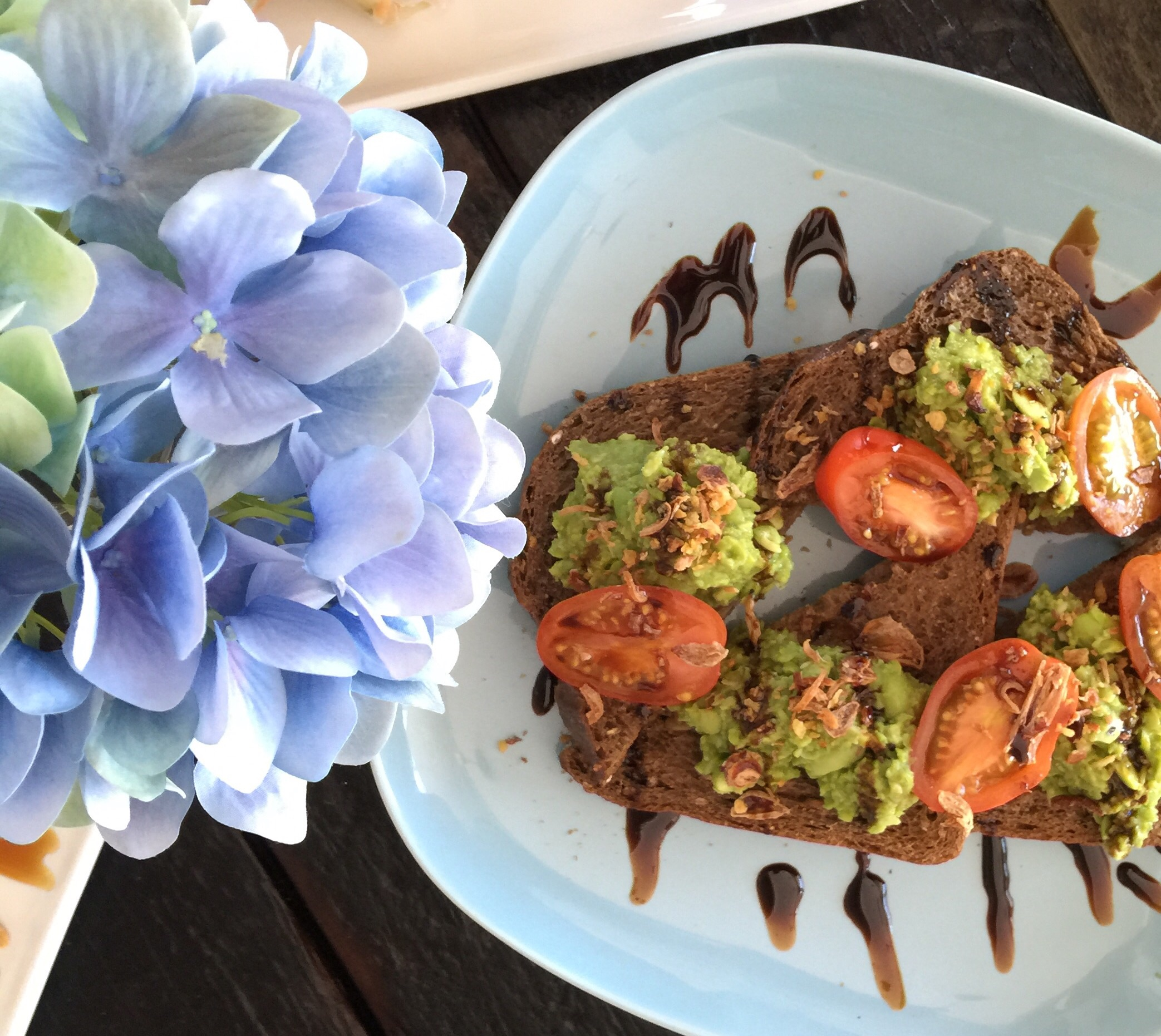 Smashed peas on rye - sweet pea, edamame, tomato, fried shallots