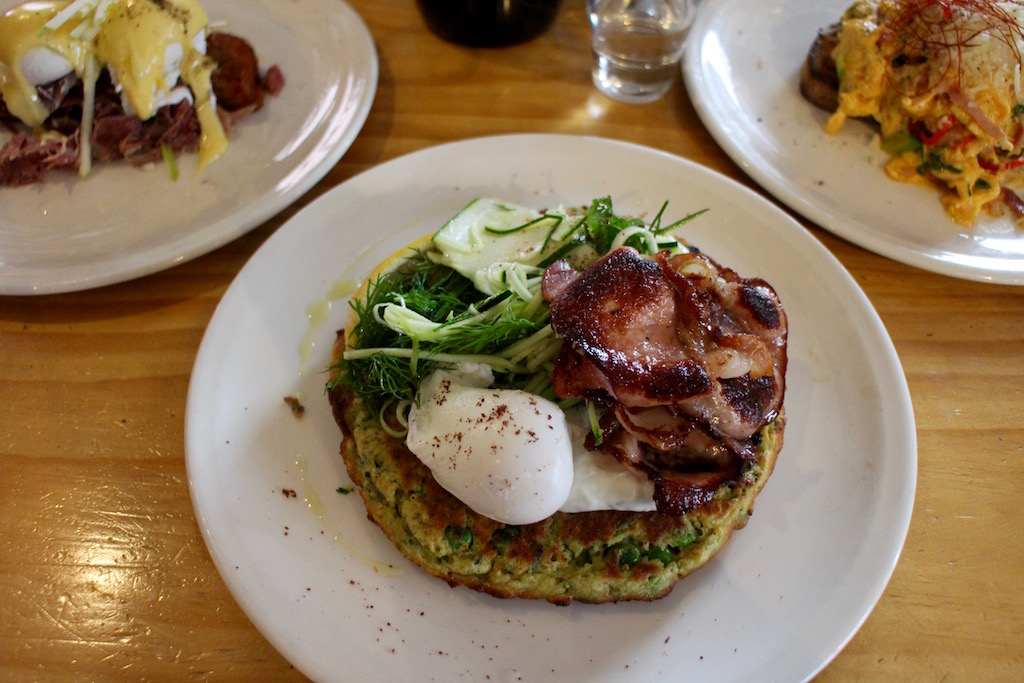 Zucchini, pea and mint fritters, zucchini, salad, poached egg and minted yoghurt. Bacon added for good luck.