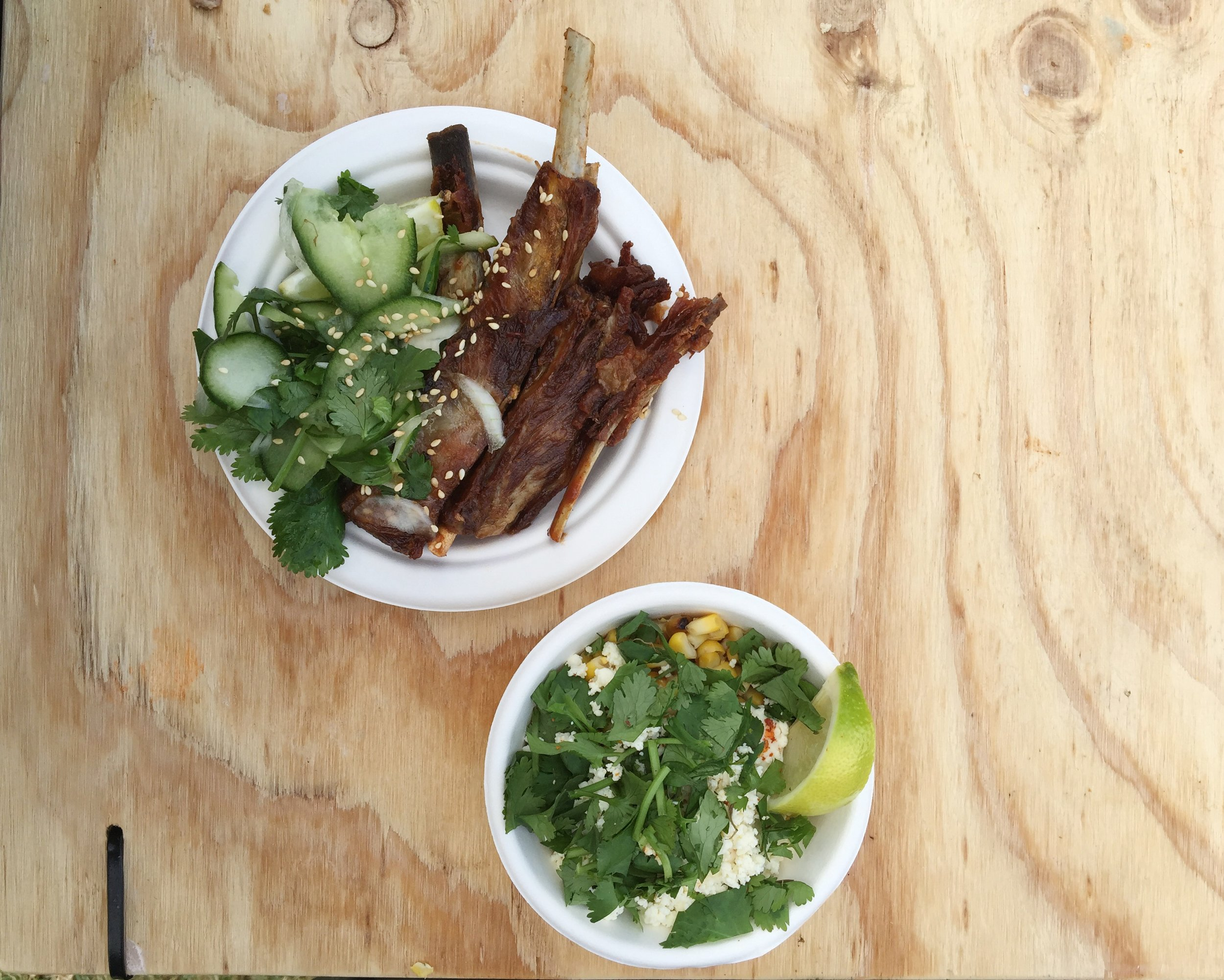 Those famous lamb ribs and a joyous serving of street corn served with crema, fresh cheese, chilli and lime.