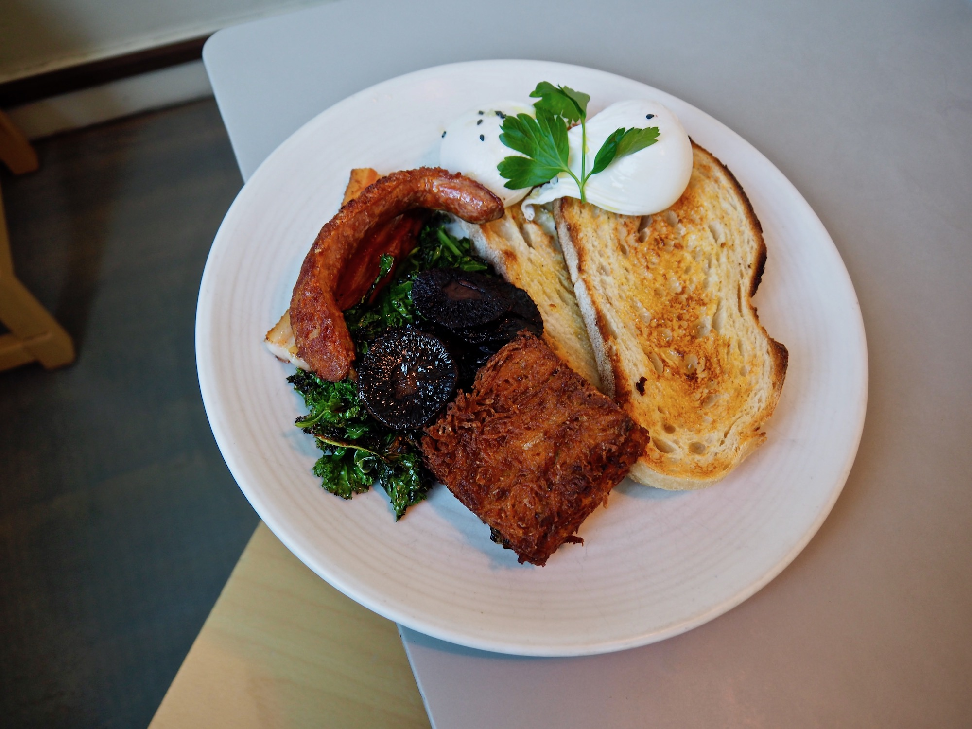 Boy's Breakfast (not real name) | thick cut bacon, sauteed kale, hash brown, sausage, two poached eggs and toast