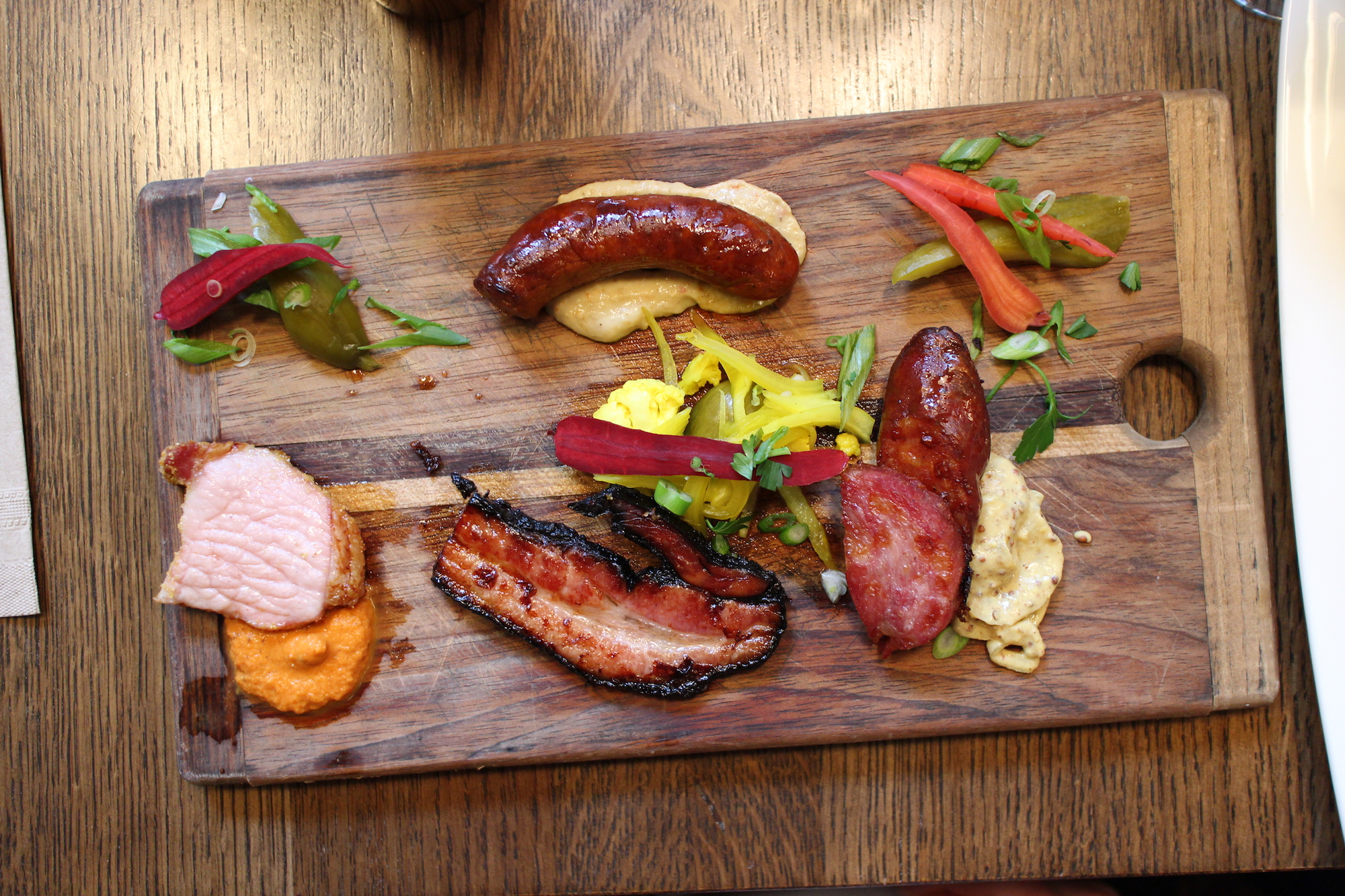 Wolves Breakfast | house cured peameal bacon, smoked medina bacon, parisienne a l'ail, andouille and merguez sausage