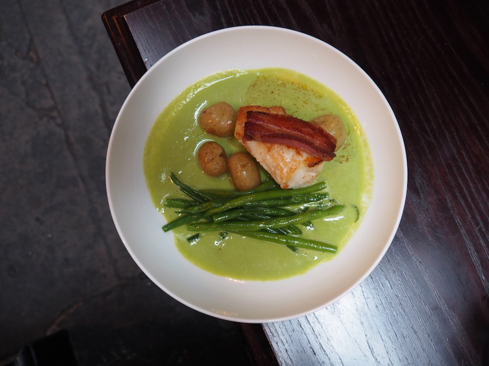 Roast Cornish monkfish, bacon and pea sauce