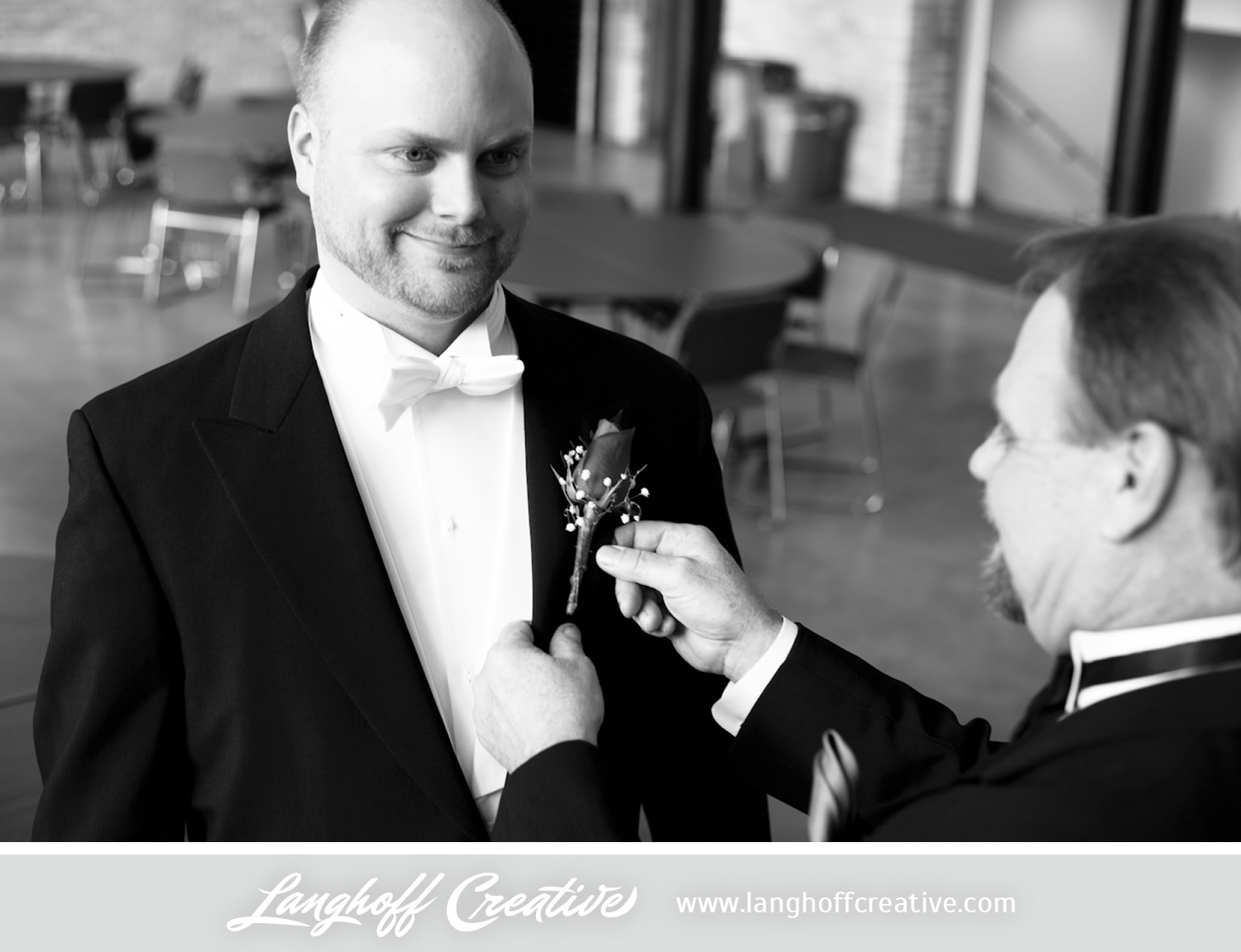 A father - son moment before the wedding.