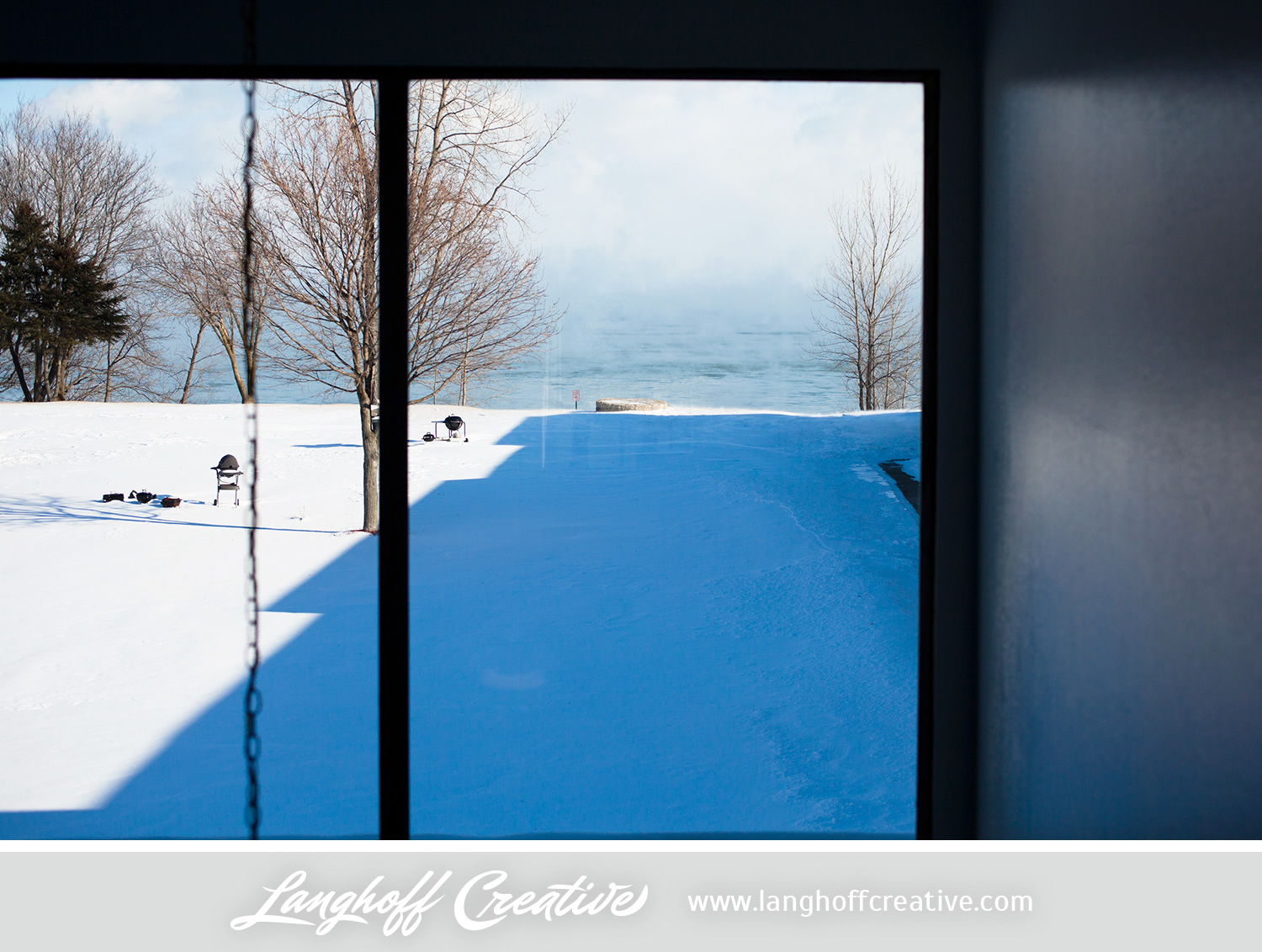 Click to view this image larger. (This is my view of Lake Michigan when peering through our apartment   hallway from the second floor.)
