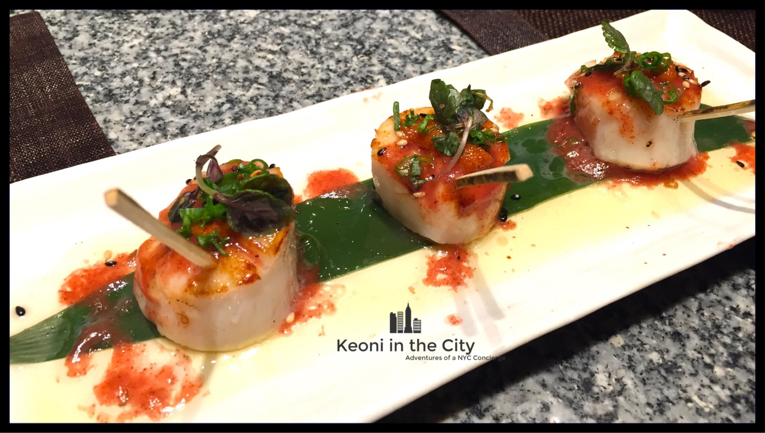 Grilled scallops with butter,  shisho  and plum