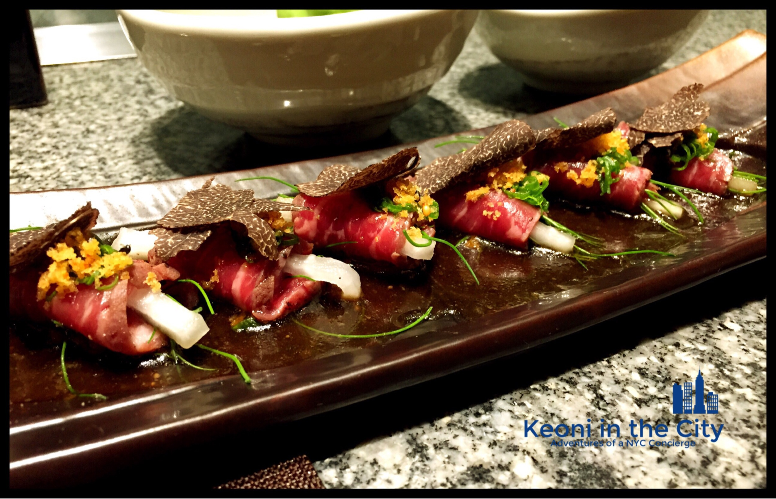 Beef  tataki  with pickled daikon and truffles