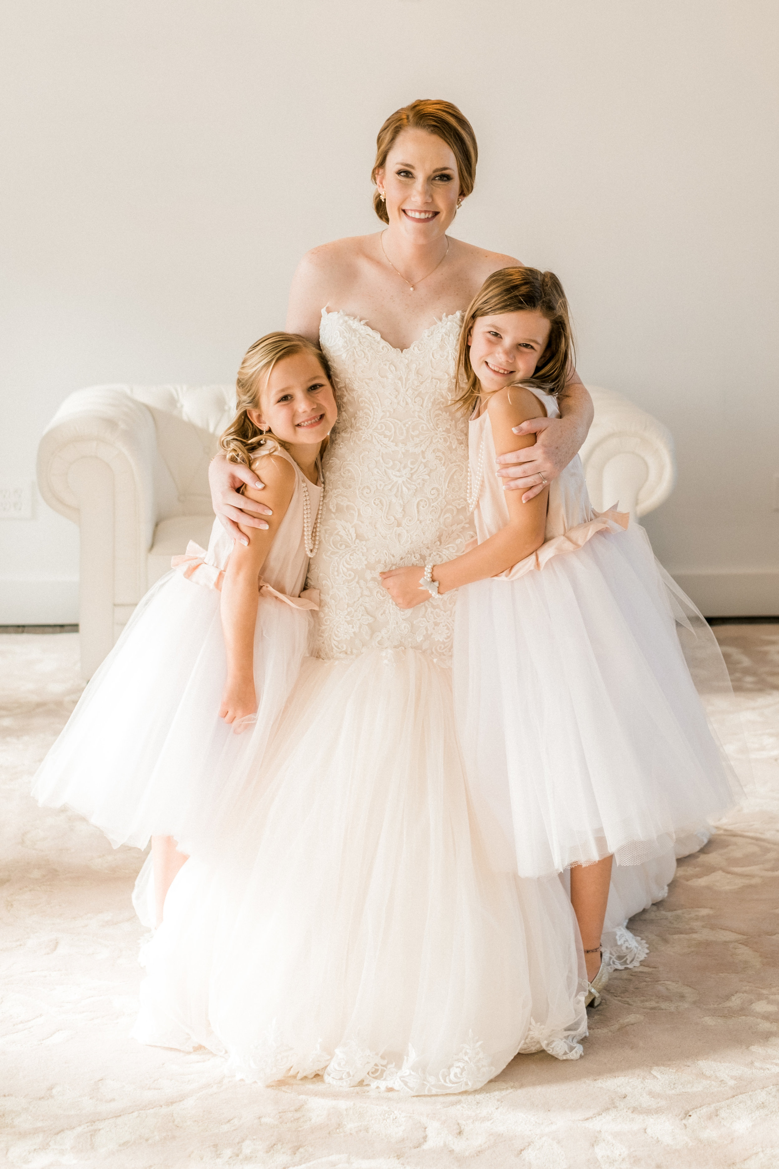 bride cuddling with flower girls in the NP Space in Brainerd, MN