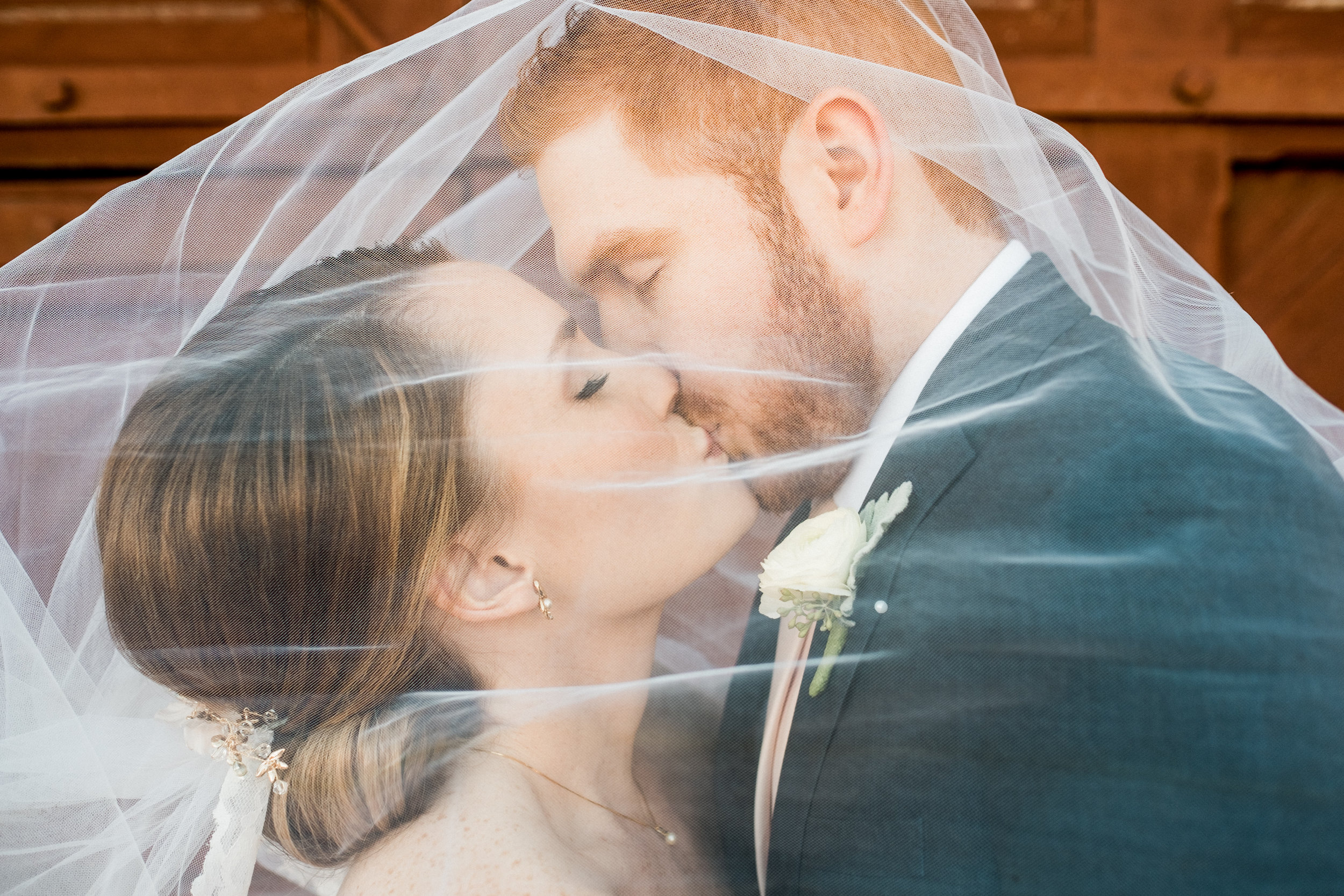 bride and groom under the veil portraits