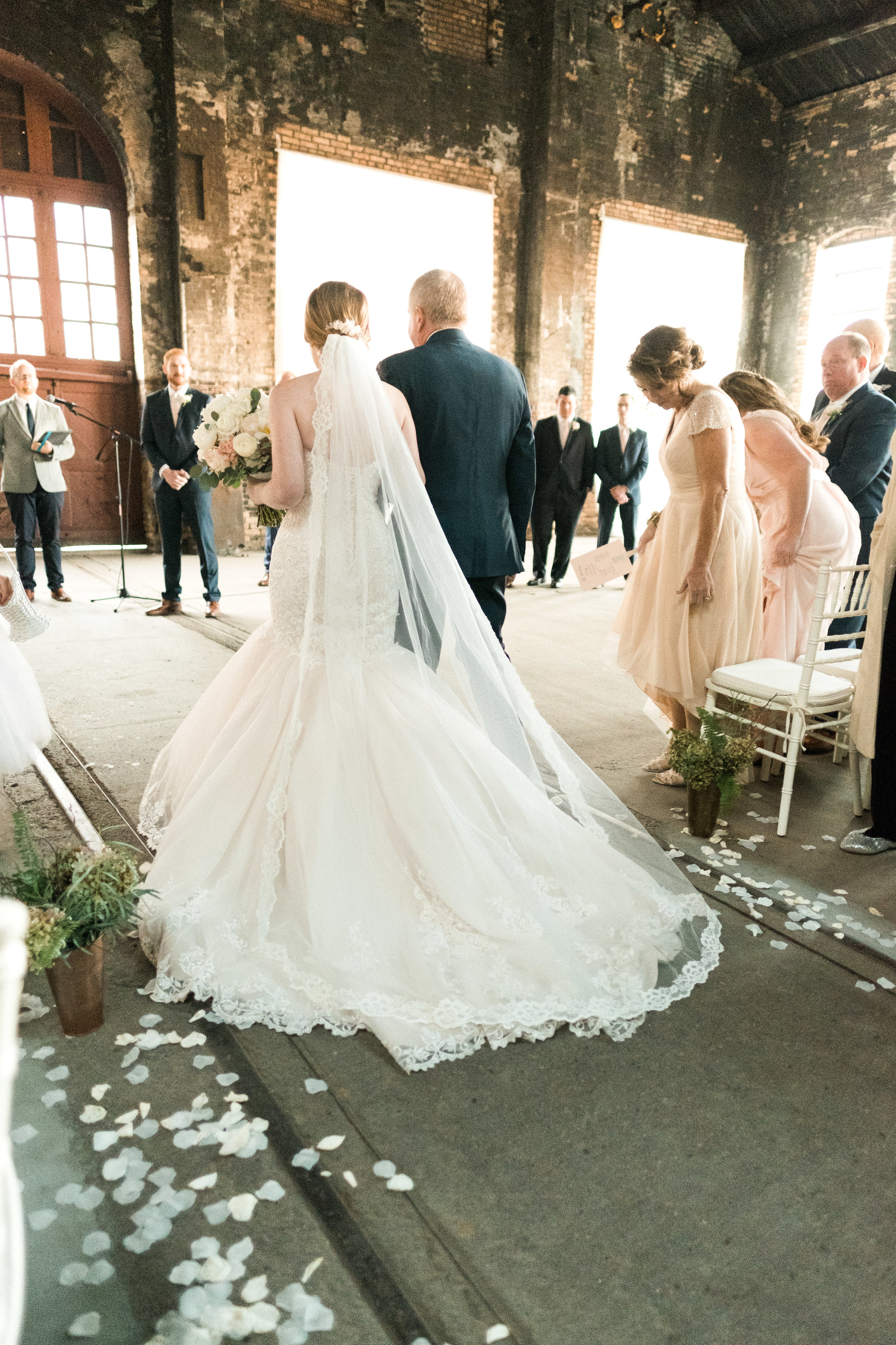 bride walking down the aisle at the NP Space