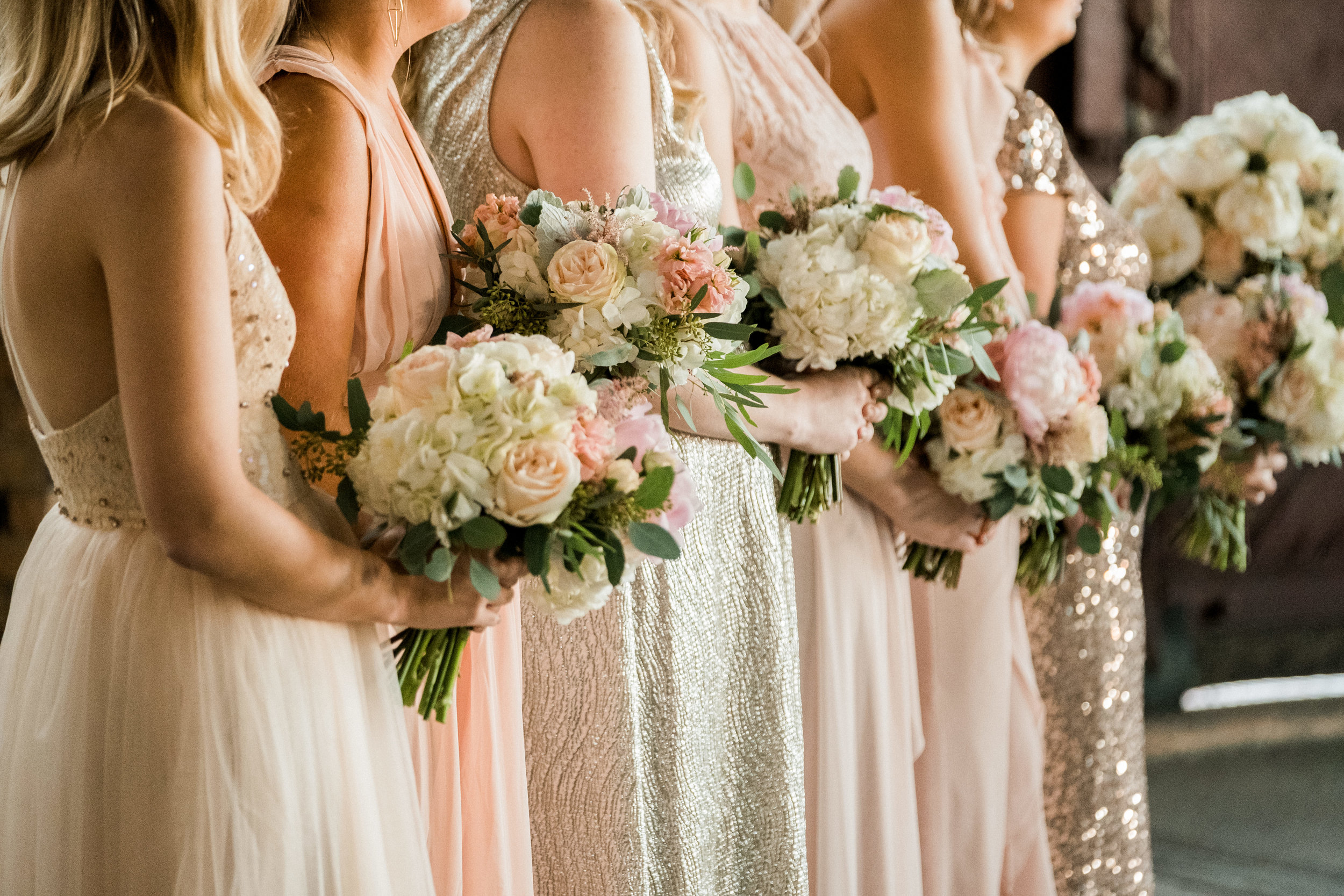 bridesmaids bouquets during the wedding ceremony
