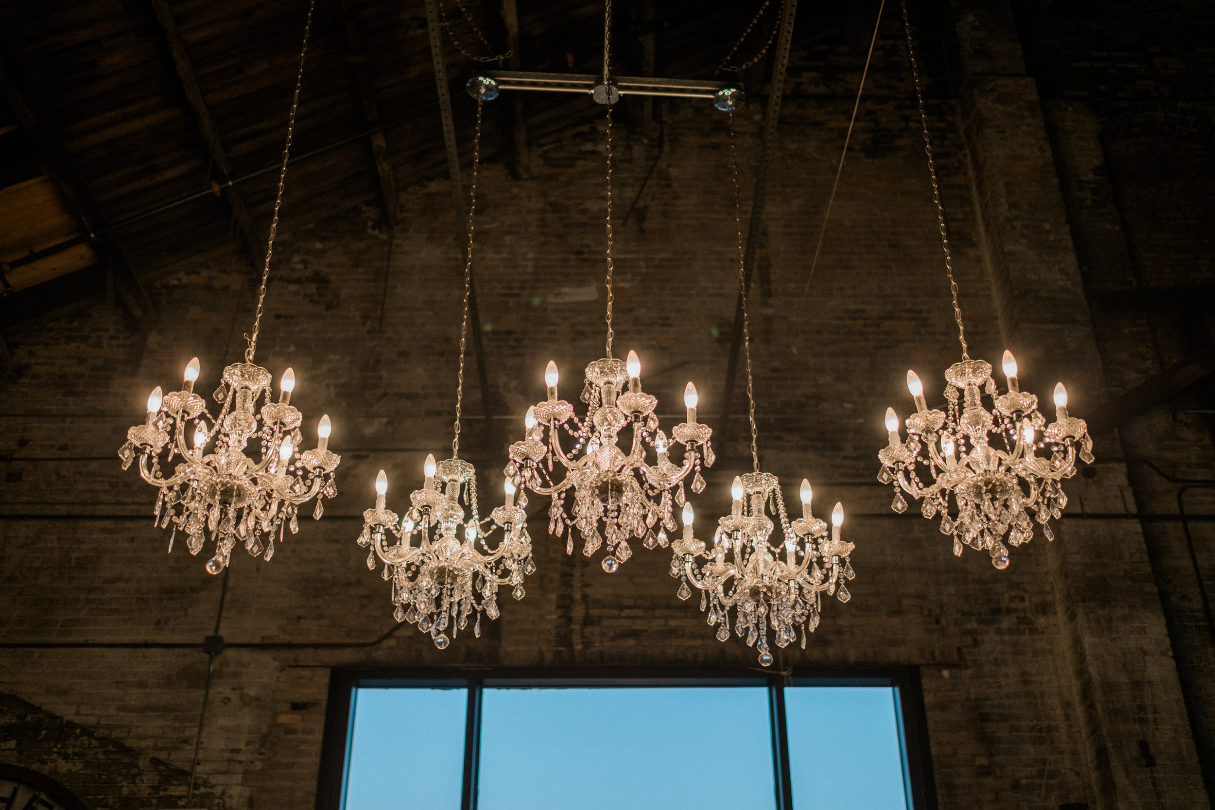 chandeliers over the entrance at the np space