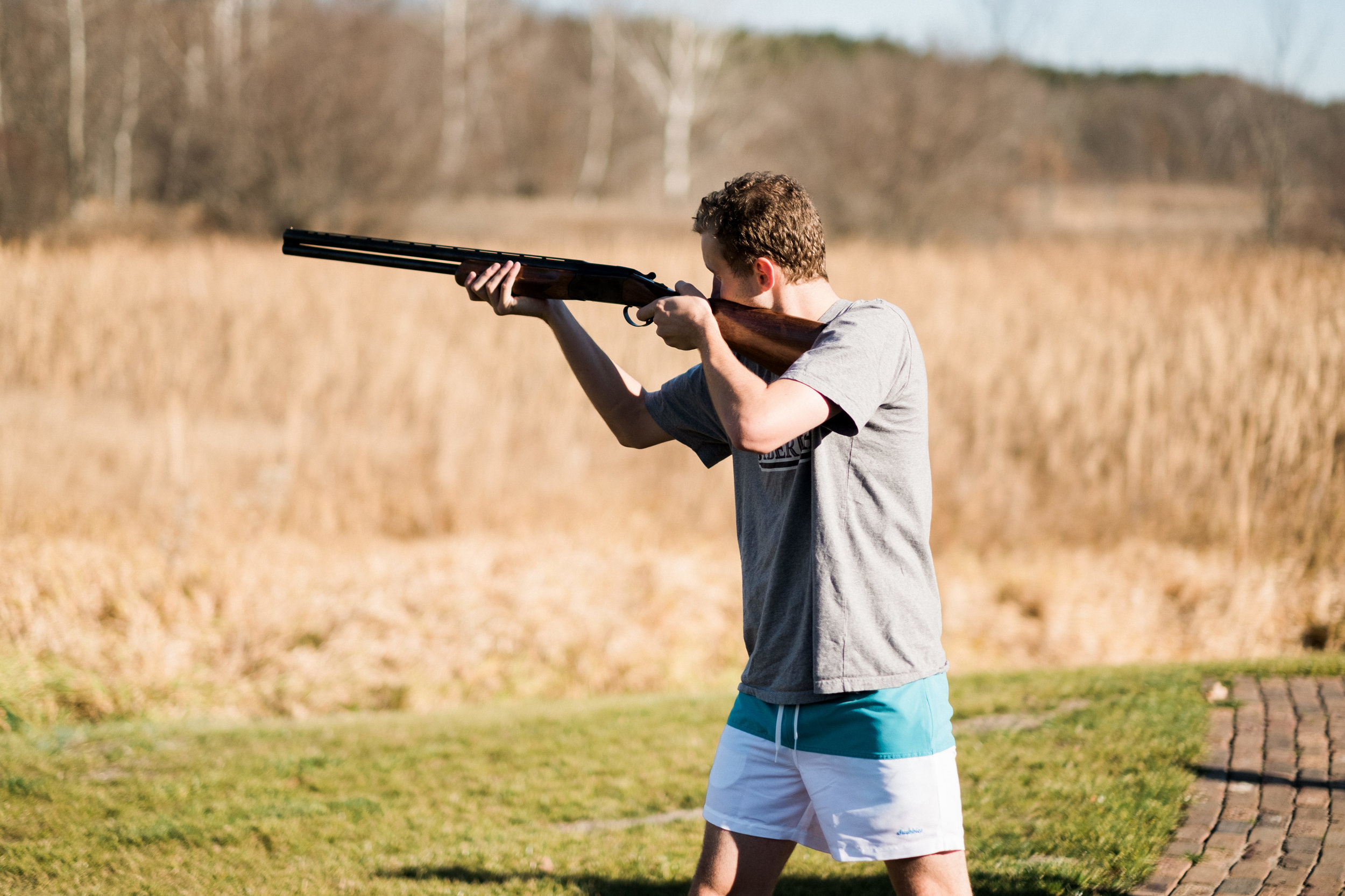 groom shooting clay target in brainerd, mn