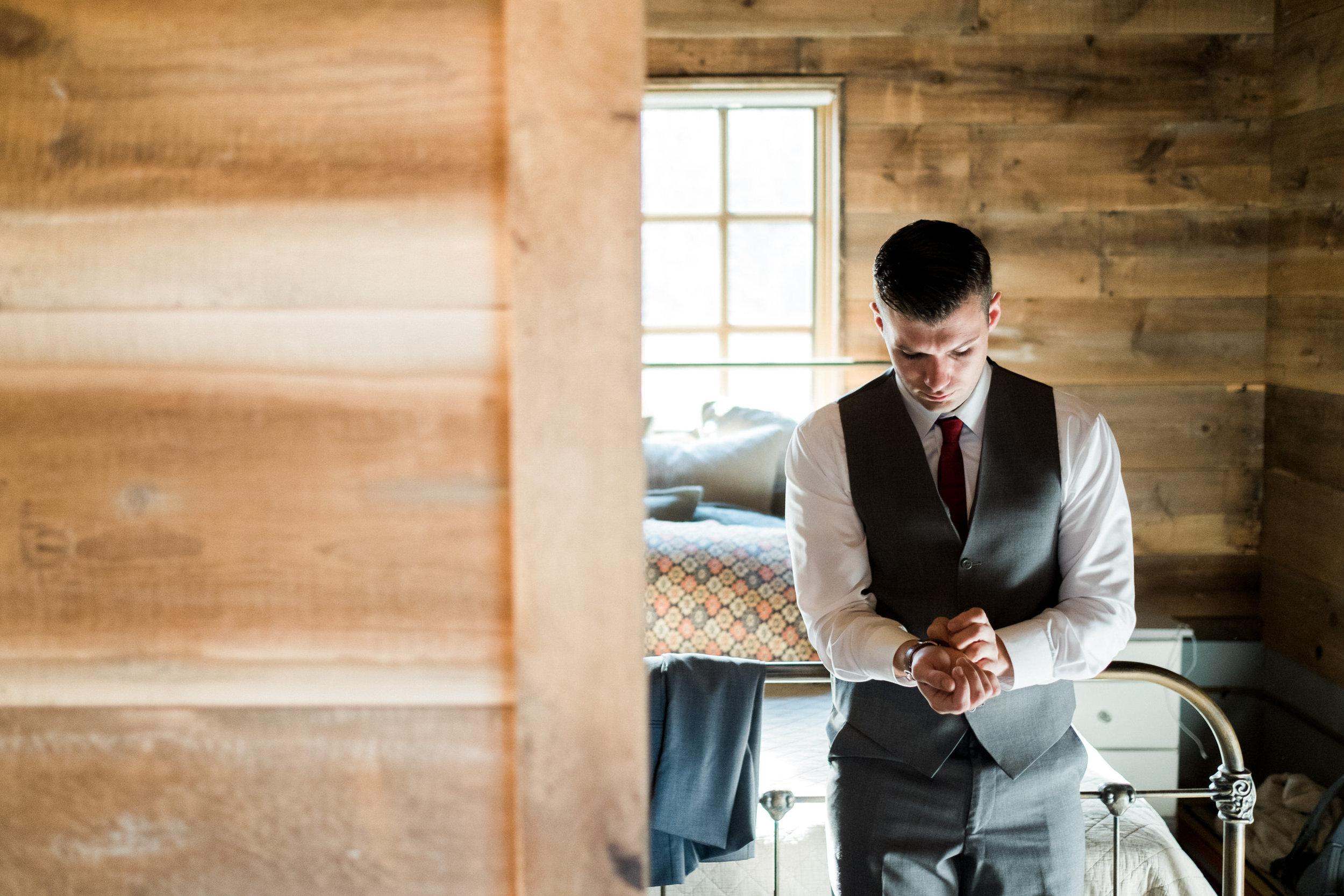 brainerd wedding photographer groom putting on watch
