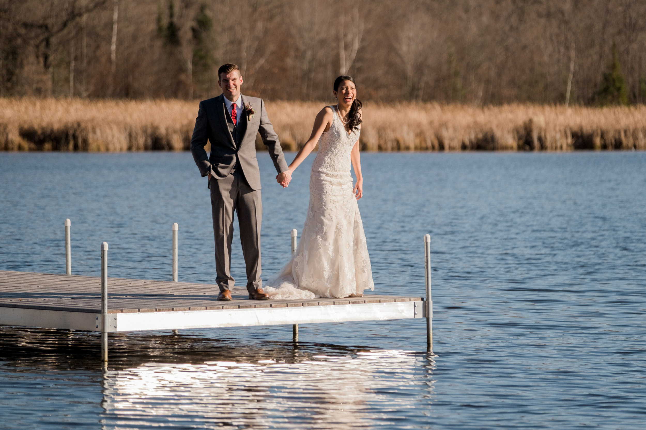 bride and groom on the dock of bay lake in brainerd, mn