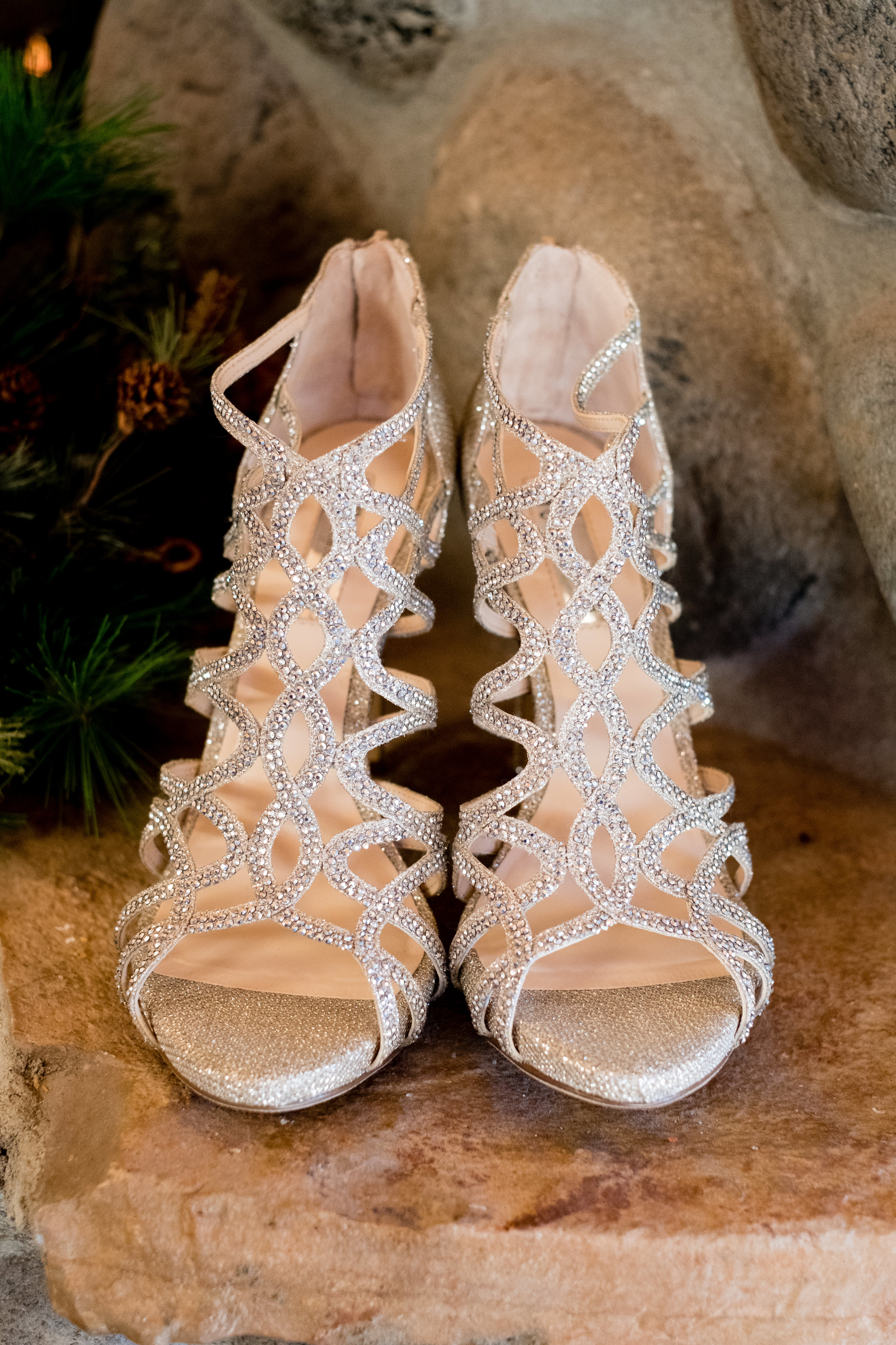 brides wedding shoes at pine peaks event center