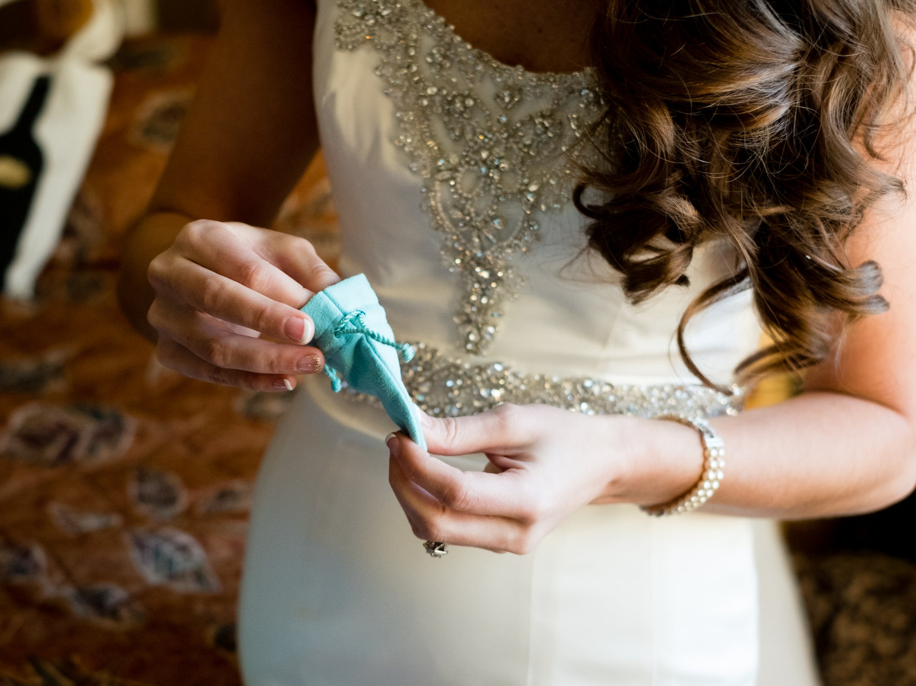 bride receiving a tiffany blue box gift for her wedding day