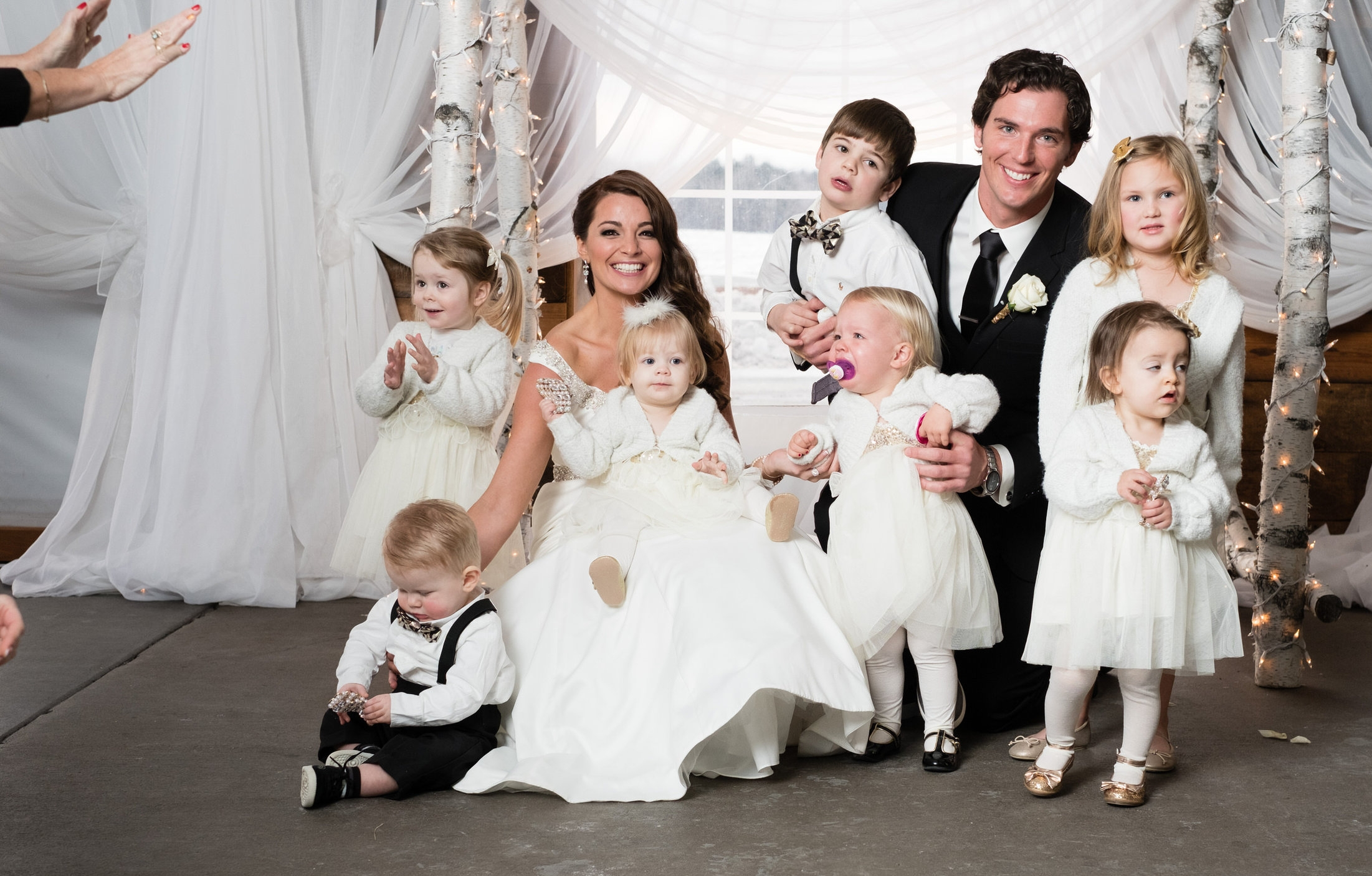 bride and groom with a bunch of crying kids!