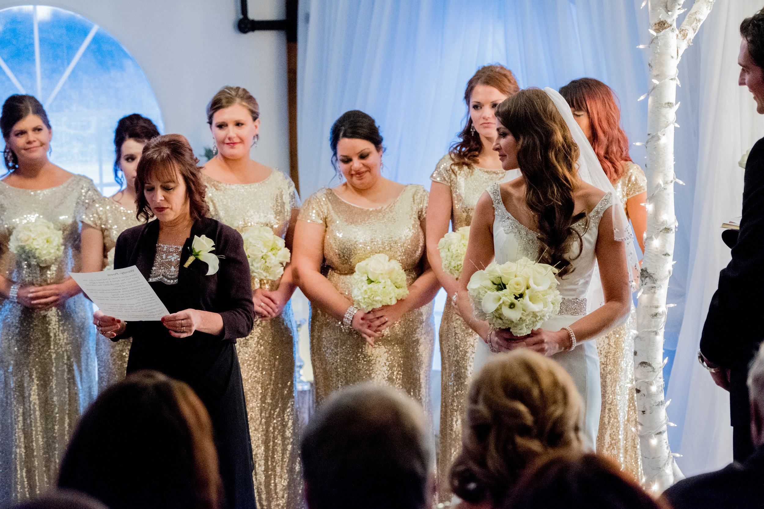 bride's mother reads the ready during the wedding ceremony at pine peaks event center