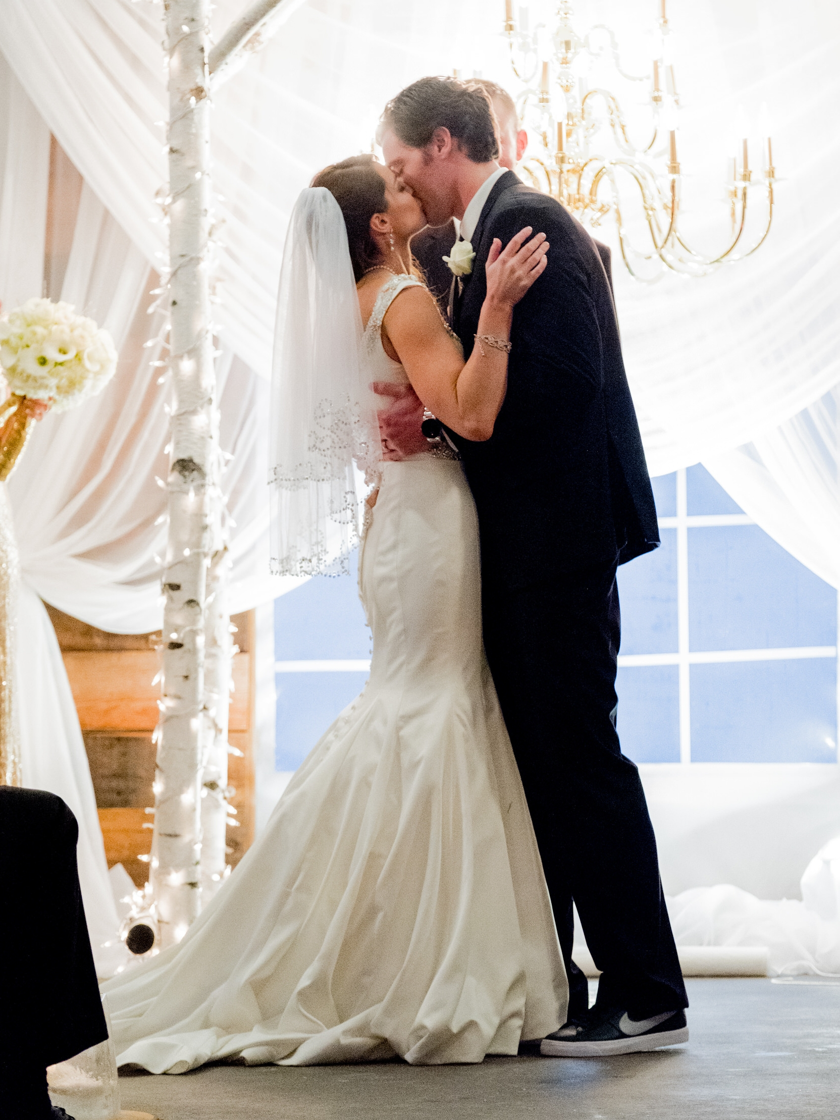 bride and groom kiss ar ceremony in crosslake, mn