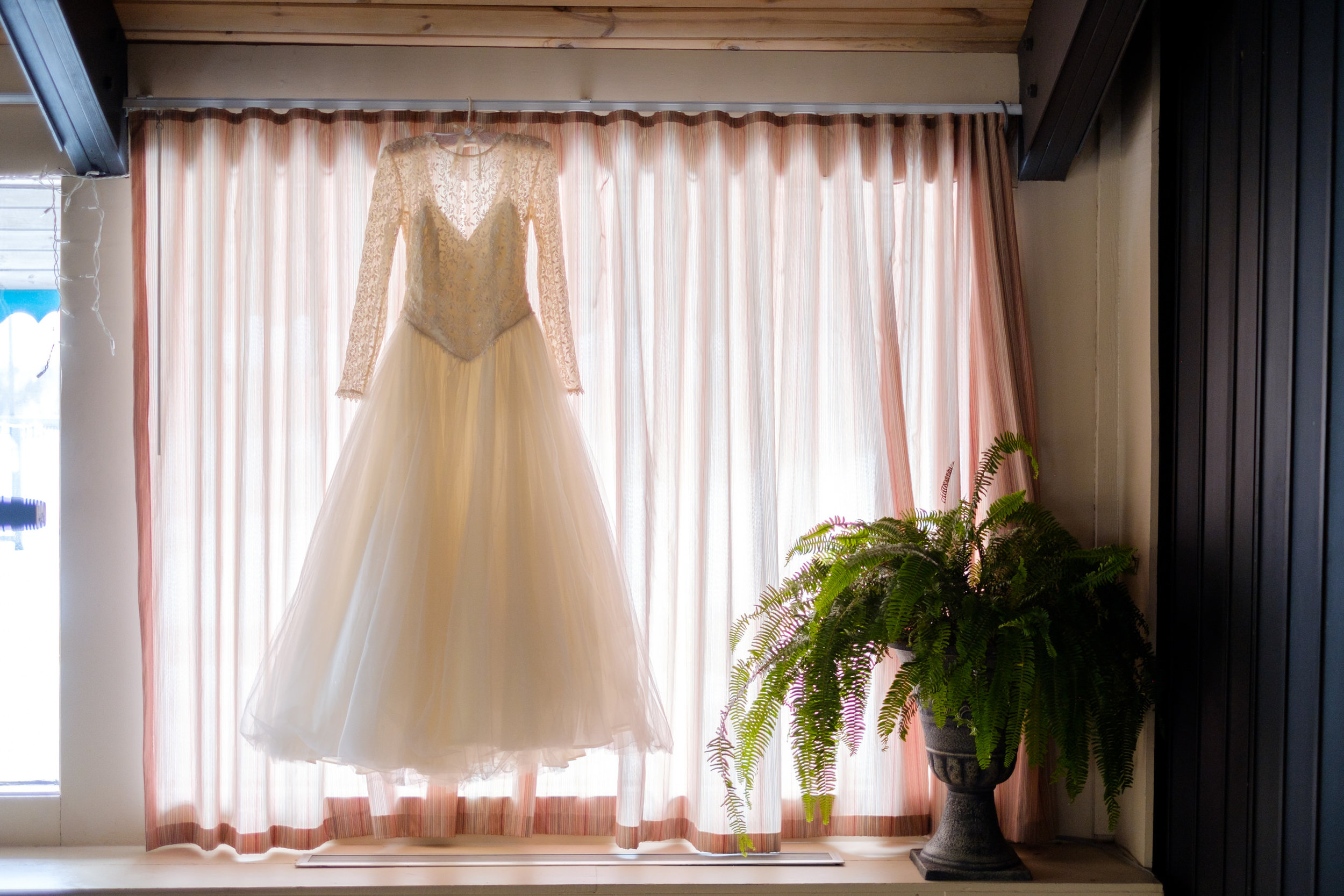 Cragun's Resort Winter Wedding Dress hanging in the window
