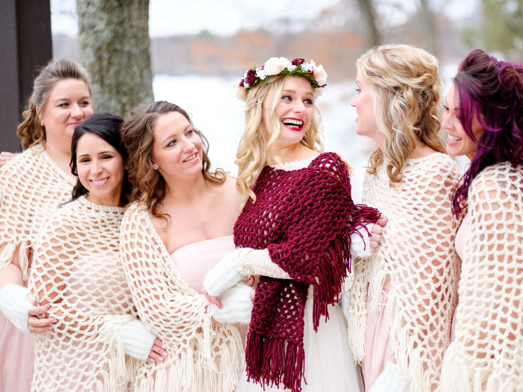 bridesmaids laughing at Cragun's Winter Wedding