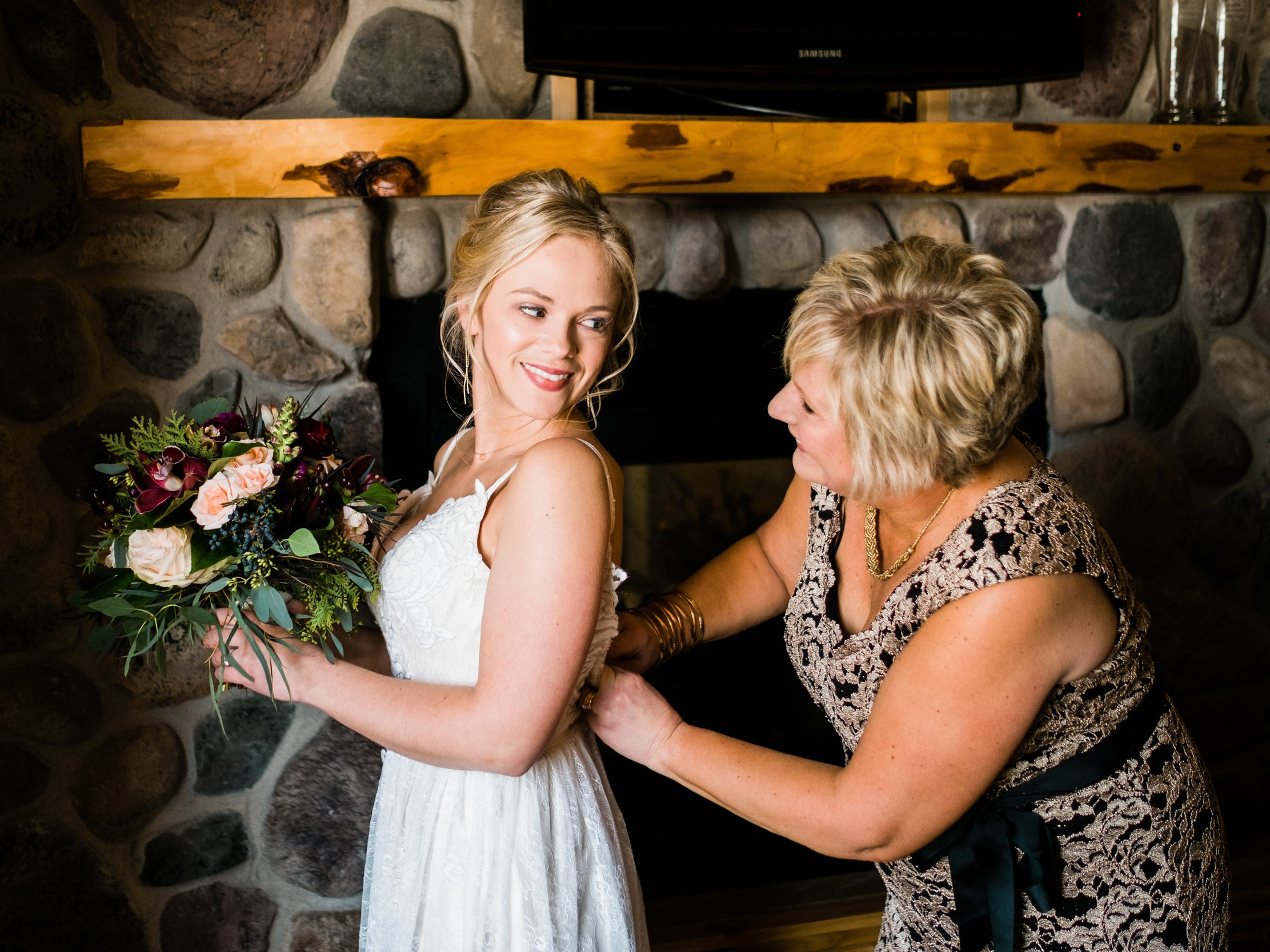 bride getting ready at pine peaks event center in crosslake, mn