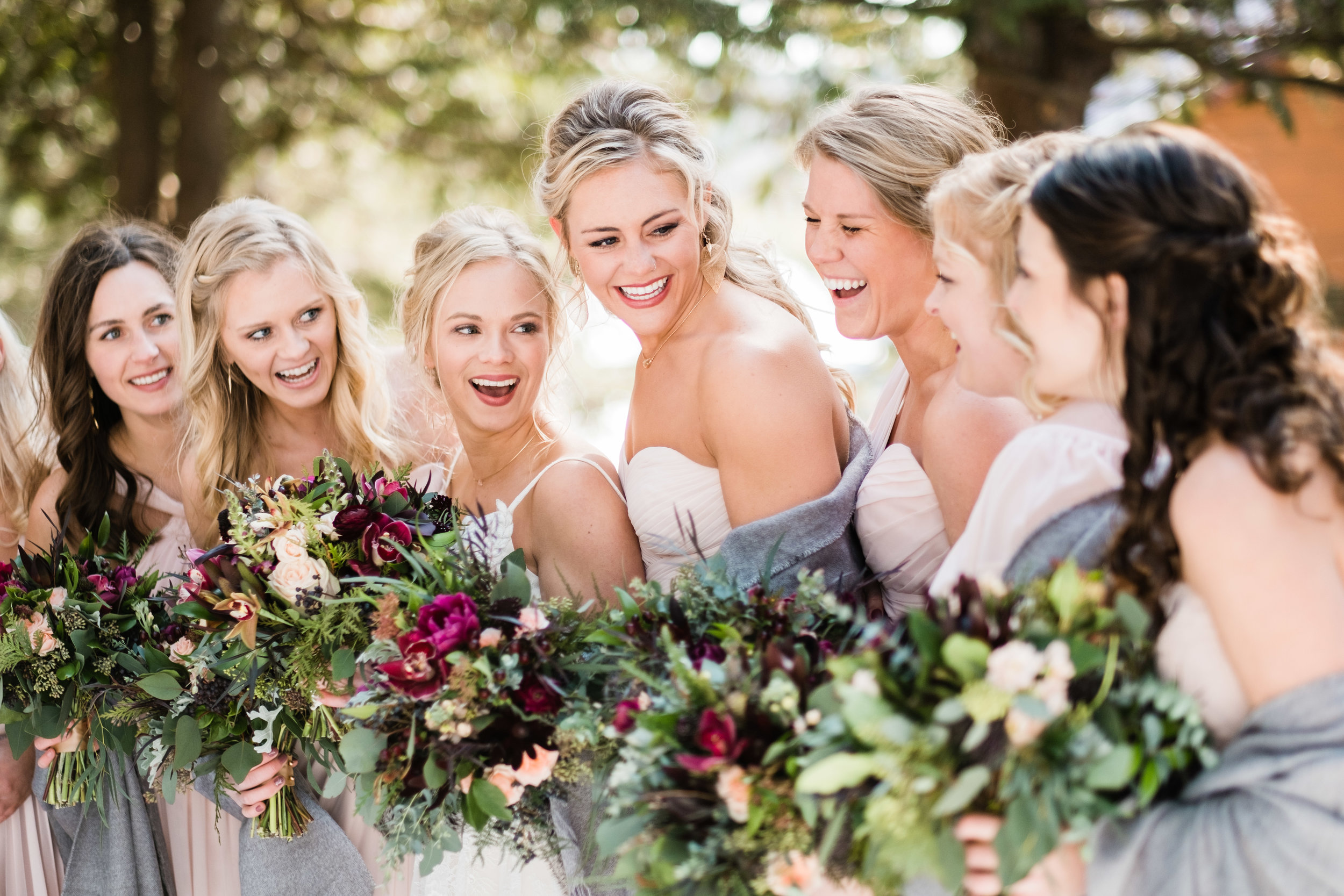 bridesmaids laughing at pine peaks winter wedding