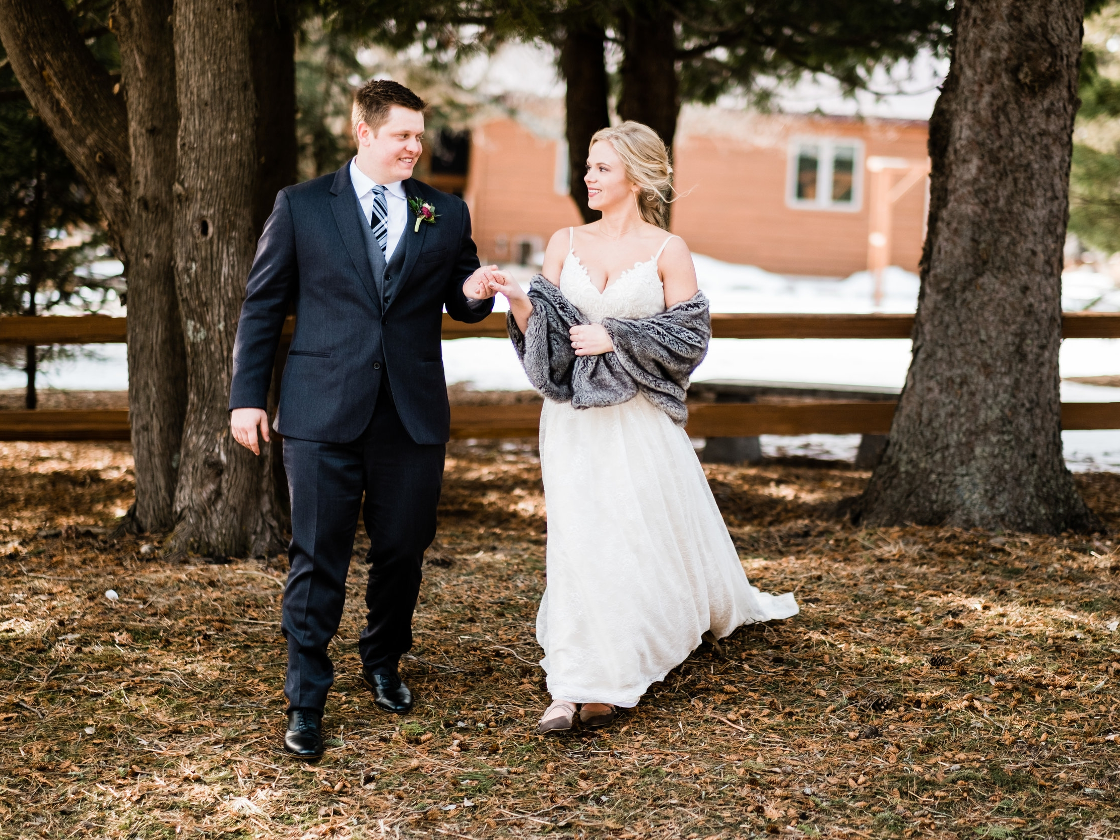 bride and groom walking outside for their brainerd winter wedding