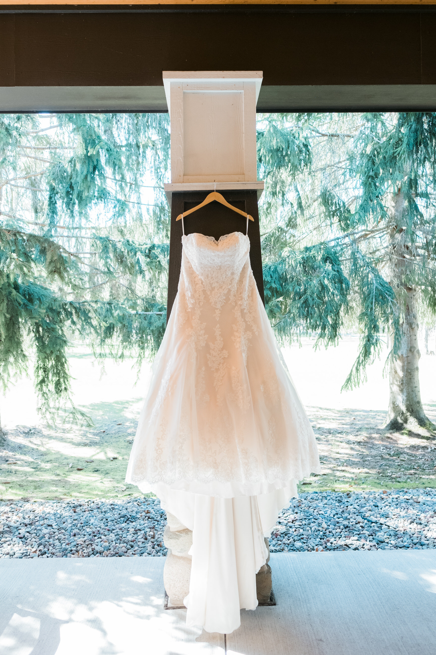 Bride's dress hanging at Grand View Lodge as she gets ready.