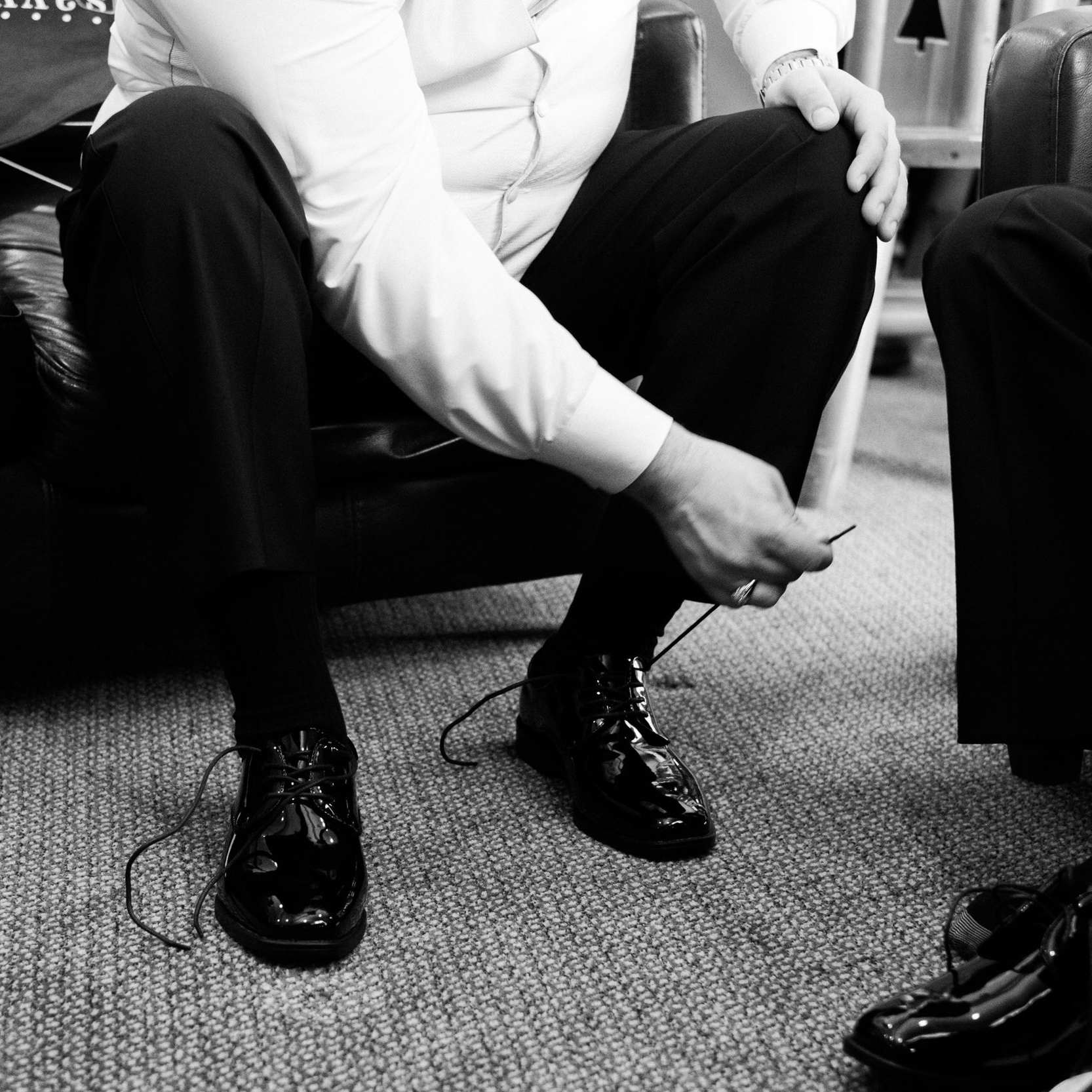 Grand View Lodge wedding groom tying shoes.