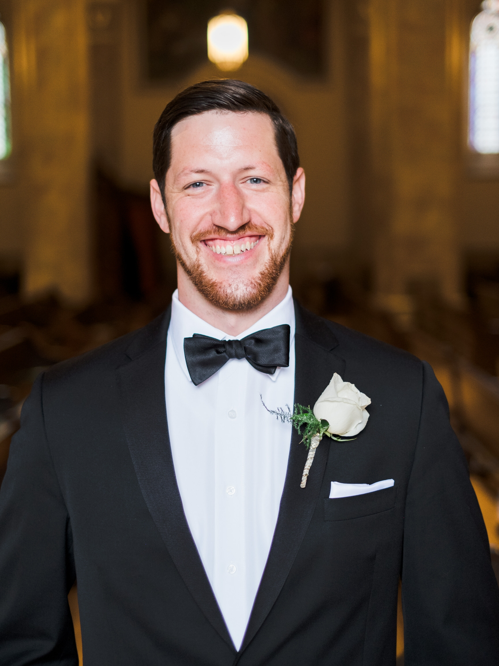 Groom portrait in downtown Saint Paul at Catholic church of the Assumption