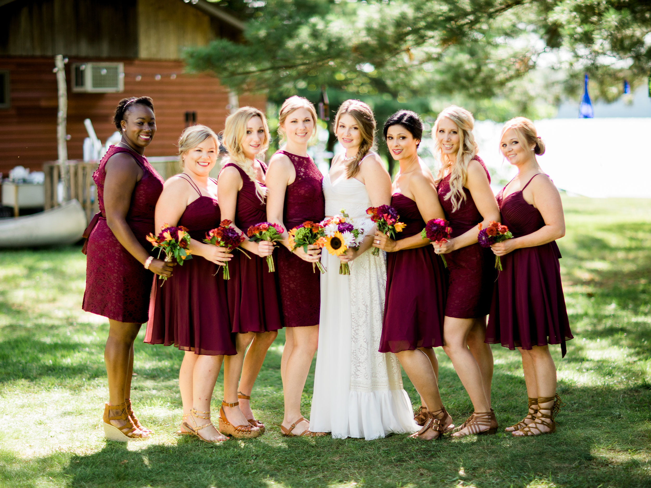Bride with her bridesmaids at her Minnesota Lake Wedding