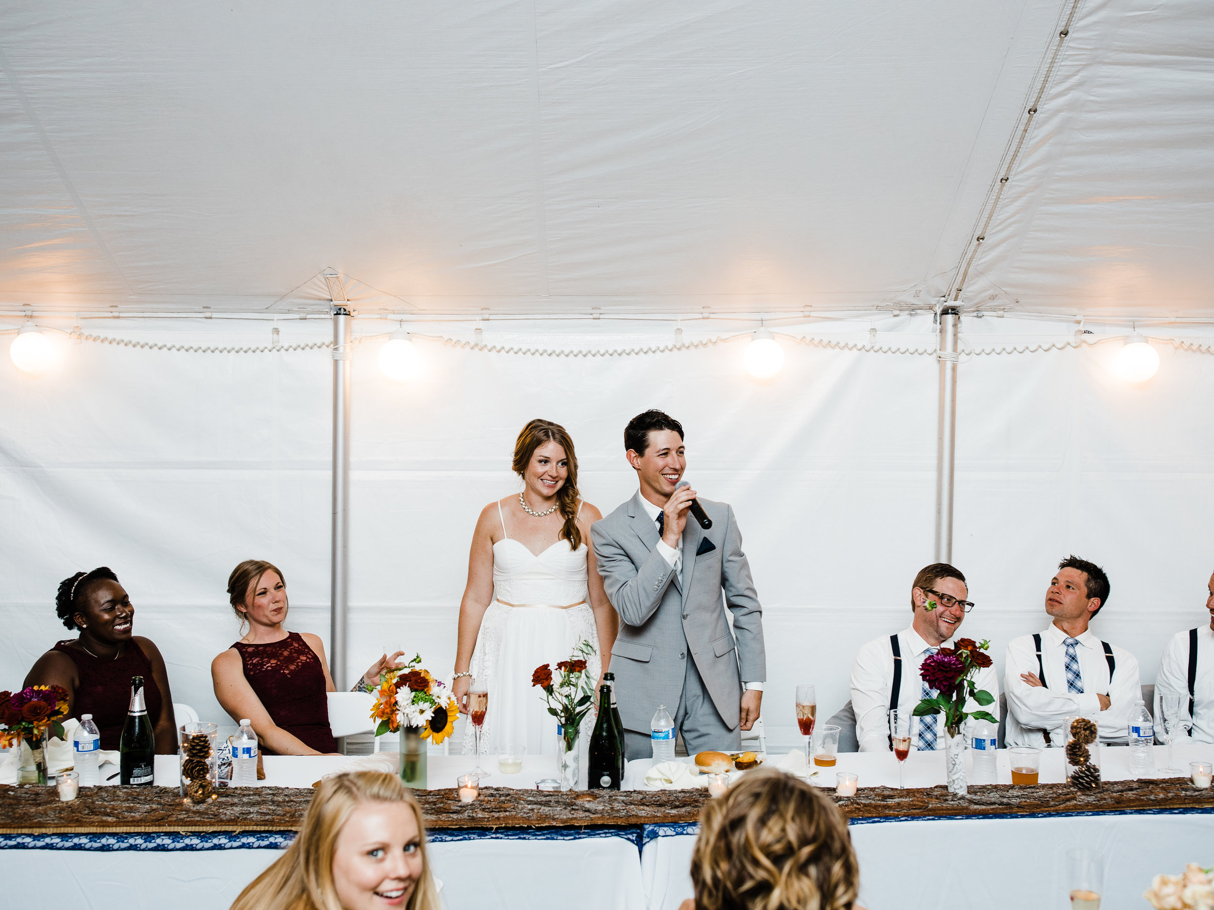 Northern Minnesota lakeside destination wedding reception in tent.