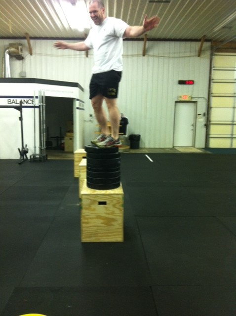 Mike Weber doing a 45 inch vertical jump onto plates that are stacked on top of a 24 inch box!