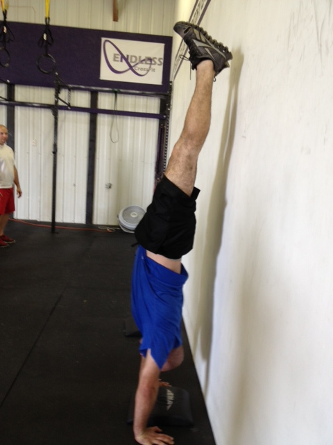 Tom working hard on his handstand holds. - Great Job Tom!!!