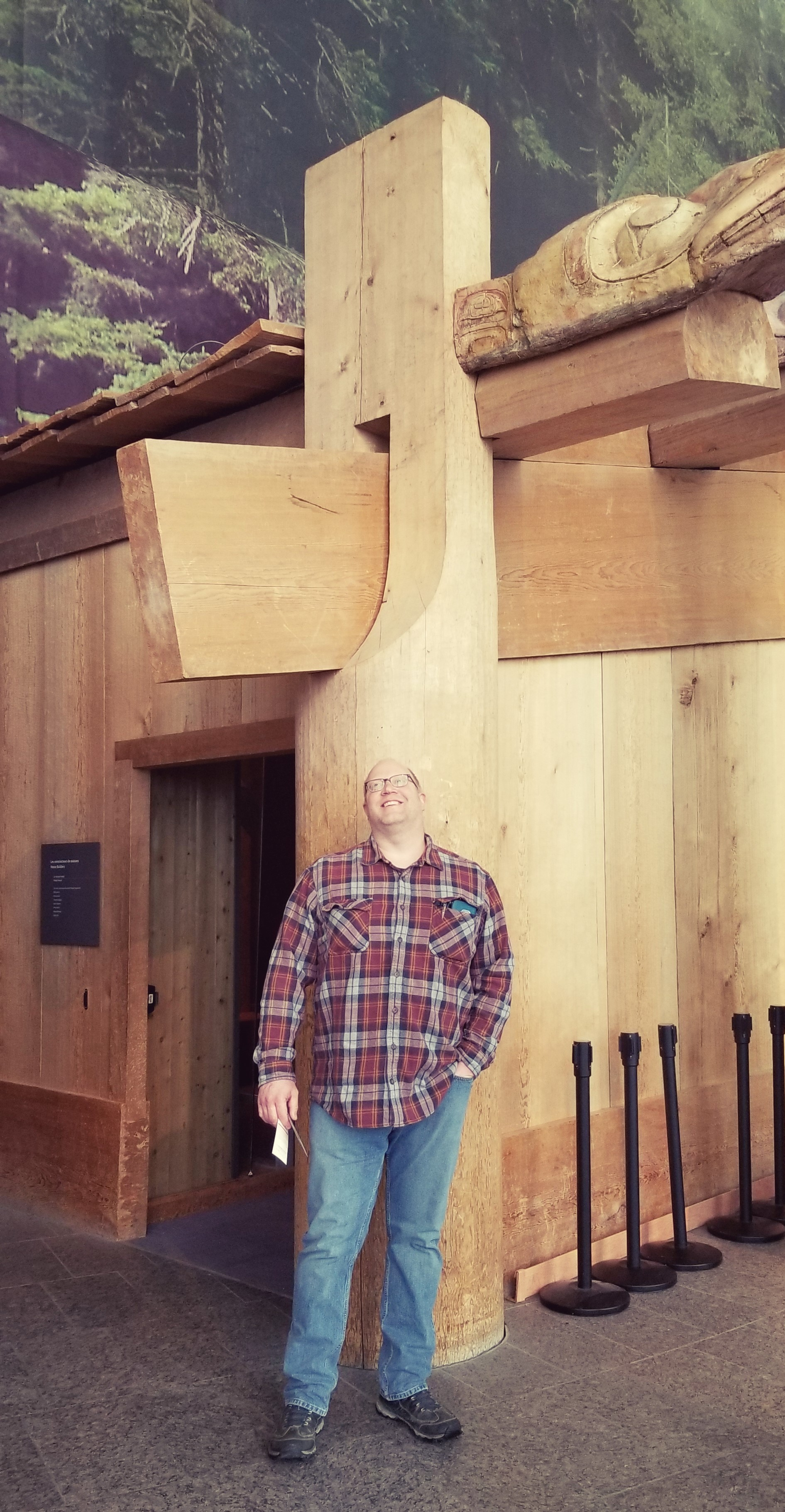 Dan admires joinery work on a reproduction timber frame home of the First People of the Northwest Coast ( Canadian Museum of History , Gatineau, Quebec)