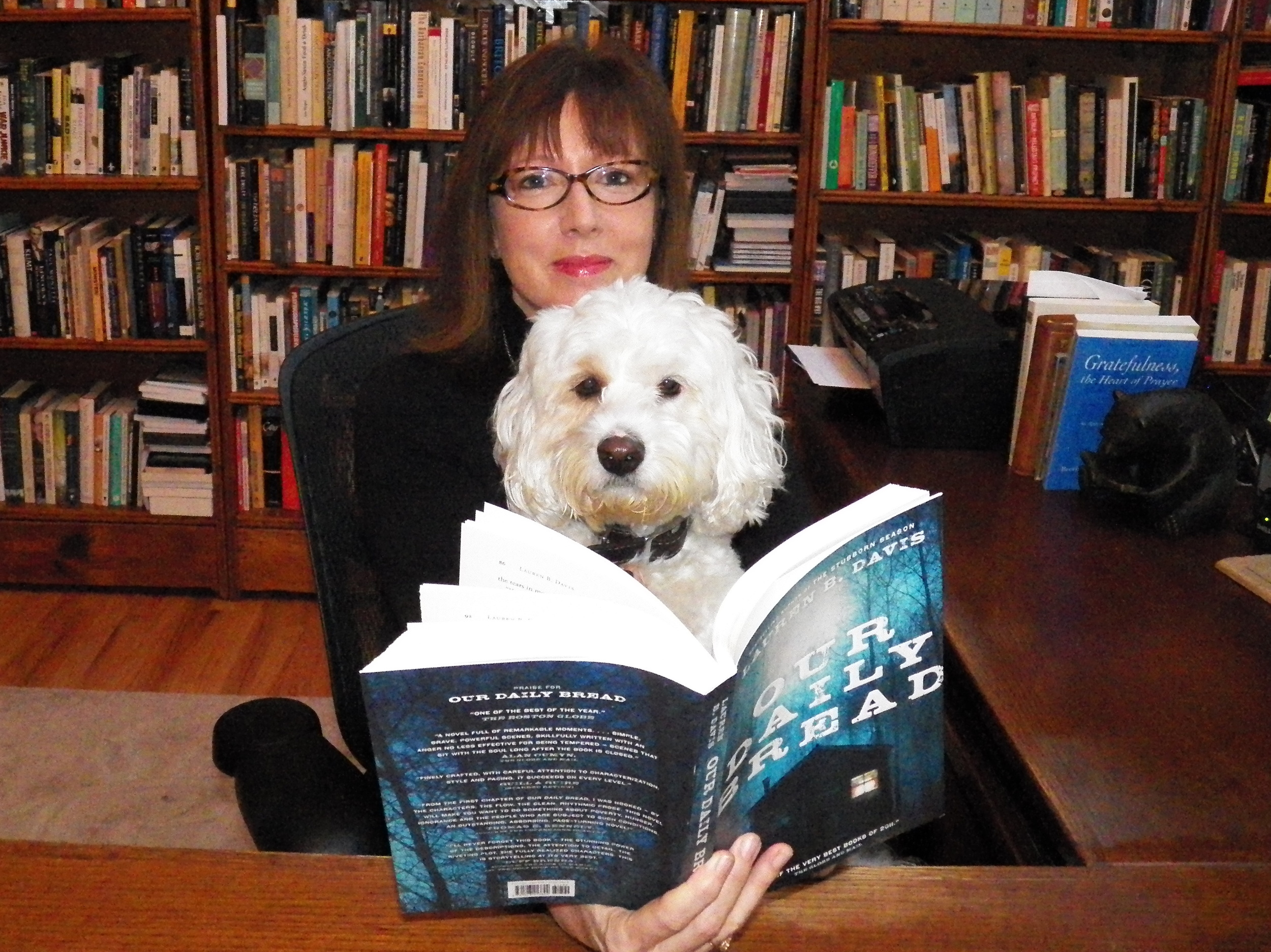 Bailey likes Lauren's book - kodak @ Sept 9 '12.jpg