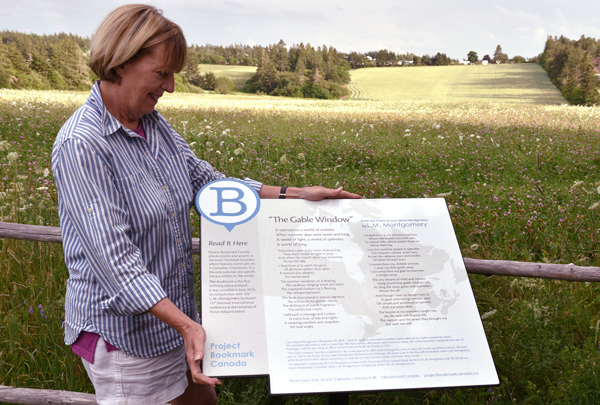 "Hughena Matheson, Project Bookmark Canada's Board President, at ""The Gable Window"" Bookmark in PEI."