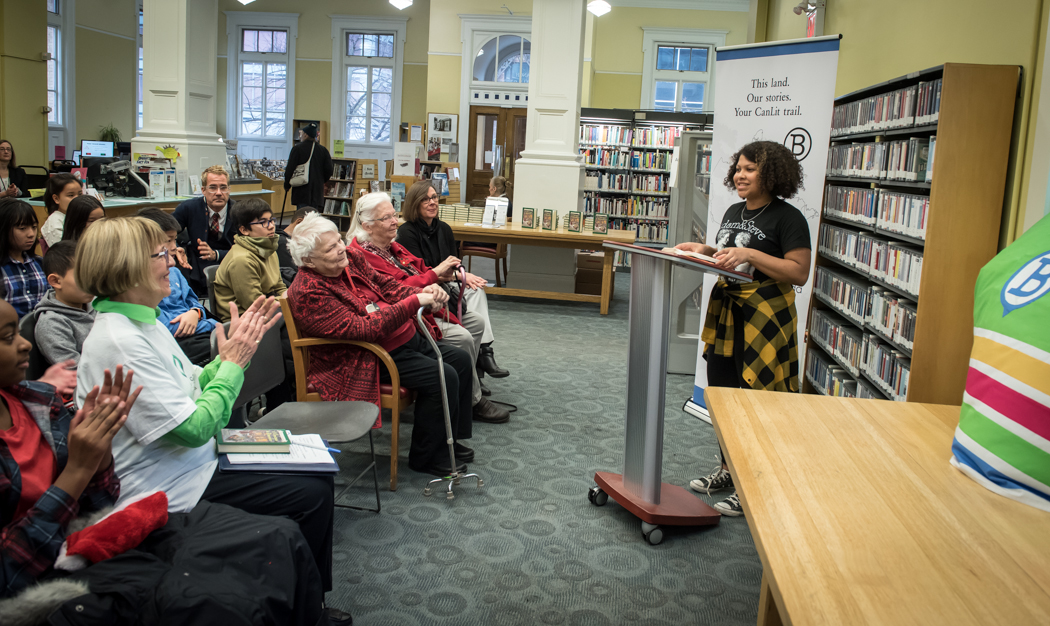 Writer Jean Little and students of Jesse Ketchum School enjoy a reading of a passage from  If I Die Before I Wake,  at Yorkville Library, Toronto. Bilingual plaques at Collier and Church Streets, supported by the Government of Canada, mark the 100th anniversary of the Spanish Flu Pandemic.