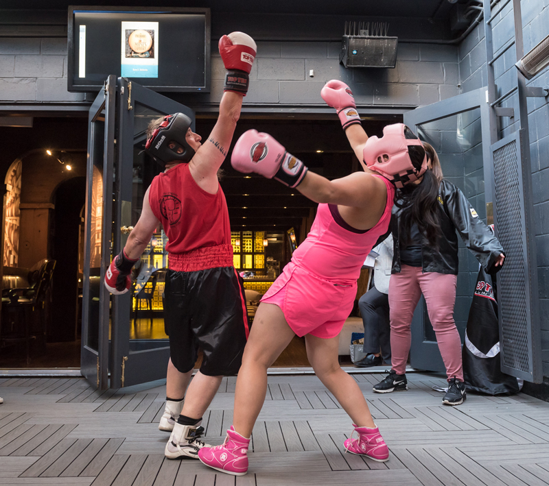Author Aren X. Tulchinsky wins a round of boxing at the Bookmark fundraiser on August 15, 2019. The boxing demo was presented by the Toronto Newsgirls Boxing Club. Photo by Lisa Sakulensky.