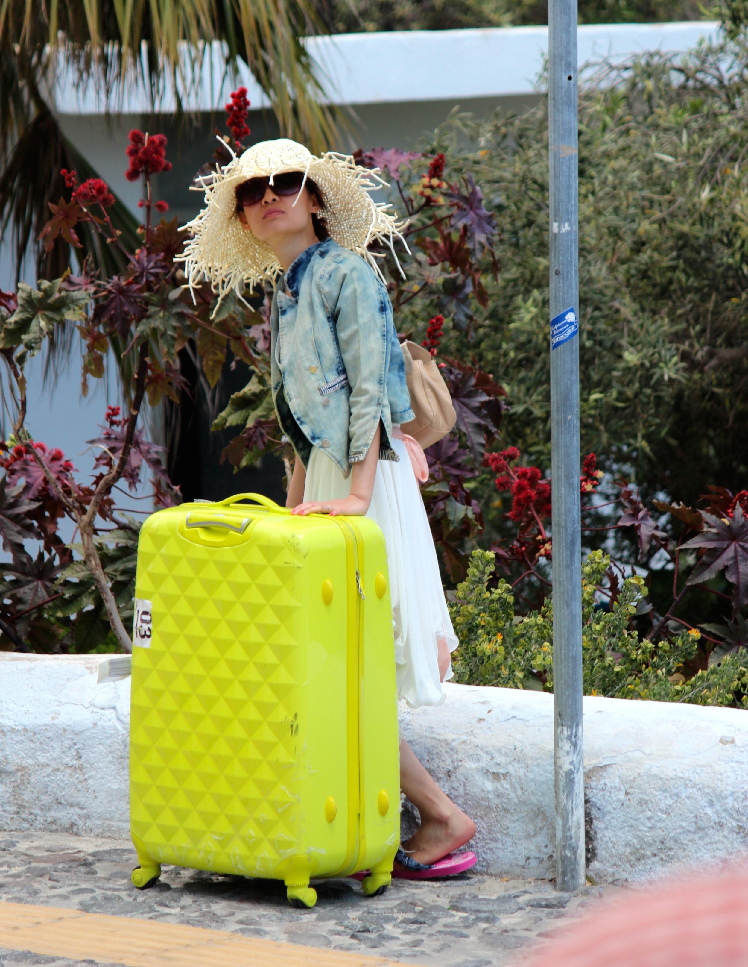 yellow suitcase girl.jpg